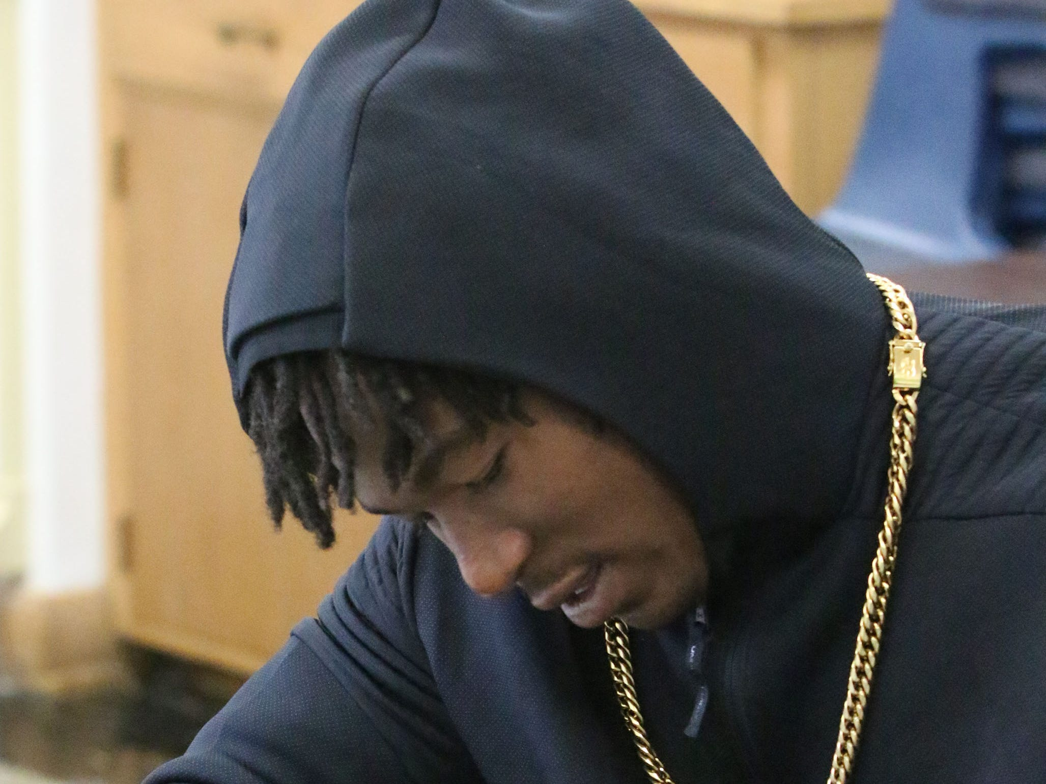 Green Bay Packer Jamaal Williams autographs photos of himself for students at St. John the Baptist Catholic School, Tuesday, November 6, 2018, in Plymouth, Wis.
