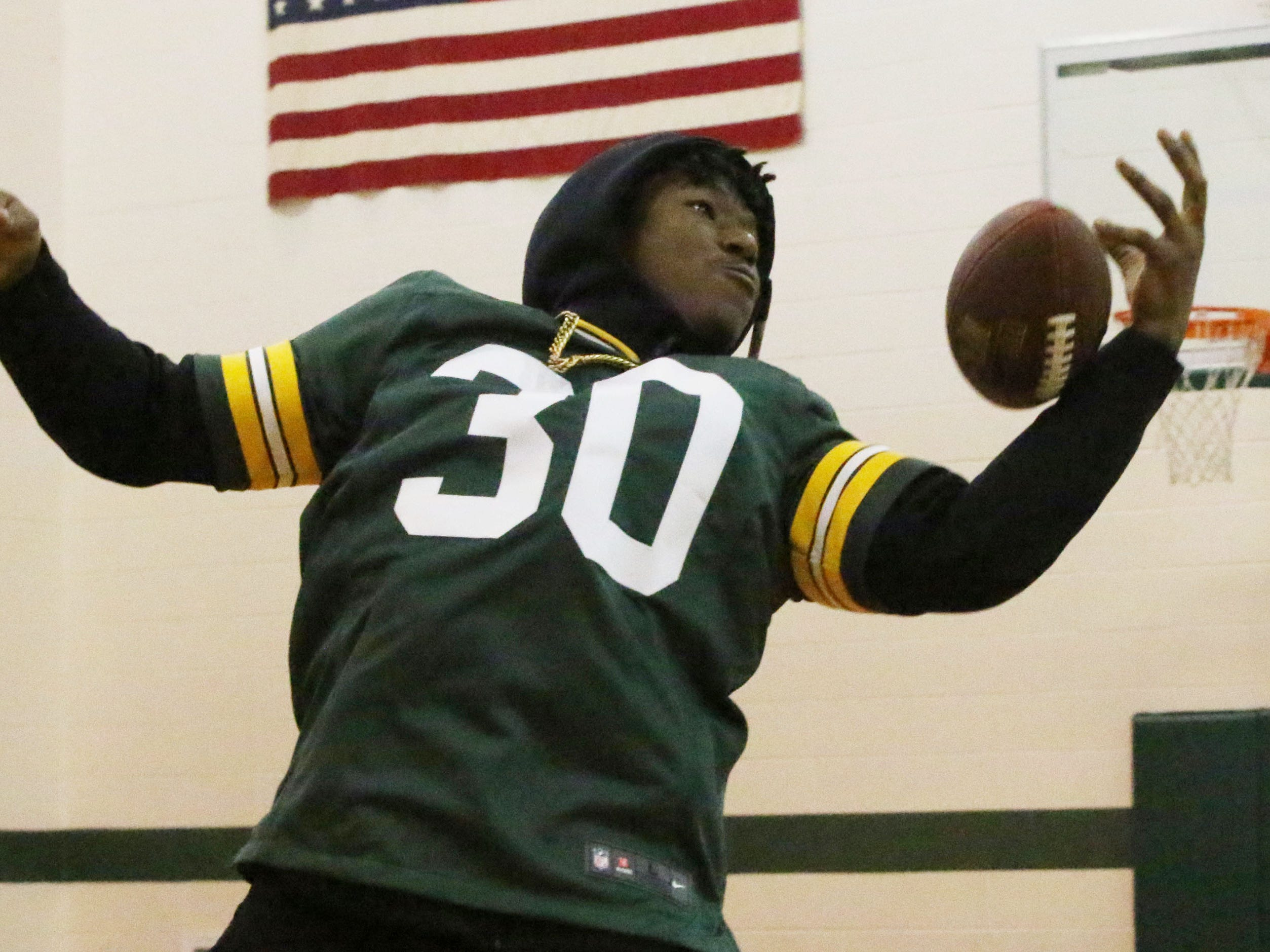 Green Bay Packer Green Bay Packer Jamaal Williams fumbles a football tossed to him during a presentation he gave at St. John the Baptist Catholic School, Tuesday, November 6, 2018, in Plymouth, Wis.