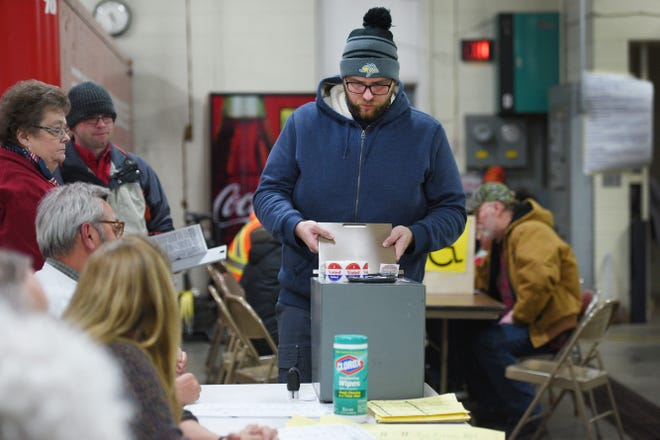 Douglas Wichern slips his ballot in for the 2018 midterm elections Tuesday, Nov. 6, at Fire Station #7 in Sioux Falls.