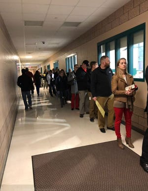 Line of people wait to vote at Memorial Middle School on Tuesday.
