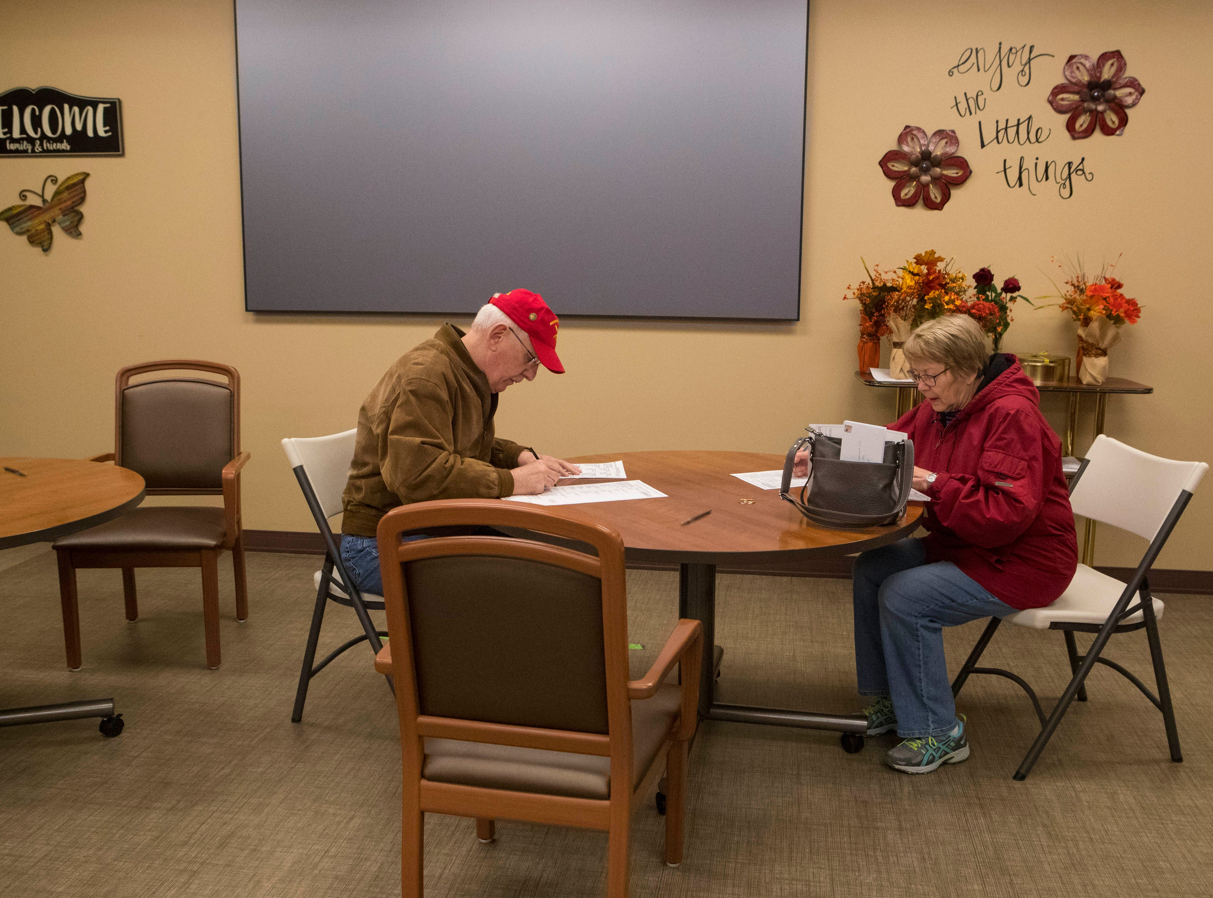Sioux Falls residents fill out their ballots at Avera Prince of Peace Retirement Community in Sioux Falls, S.D., Tuesday, Nov. 6, 2018.