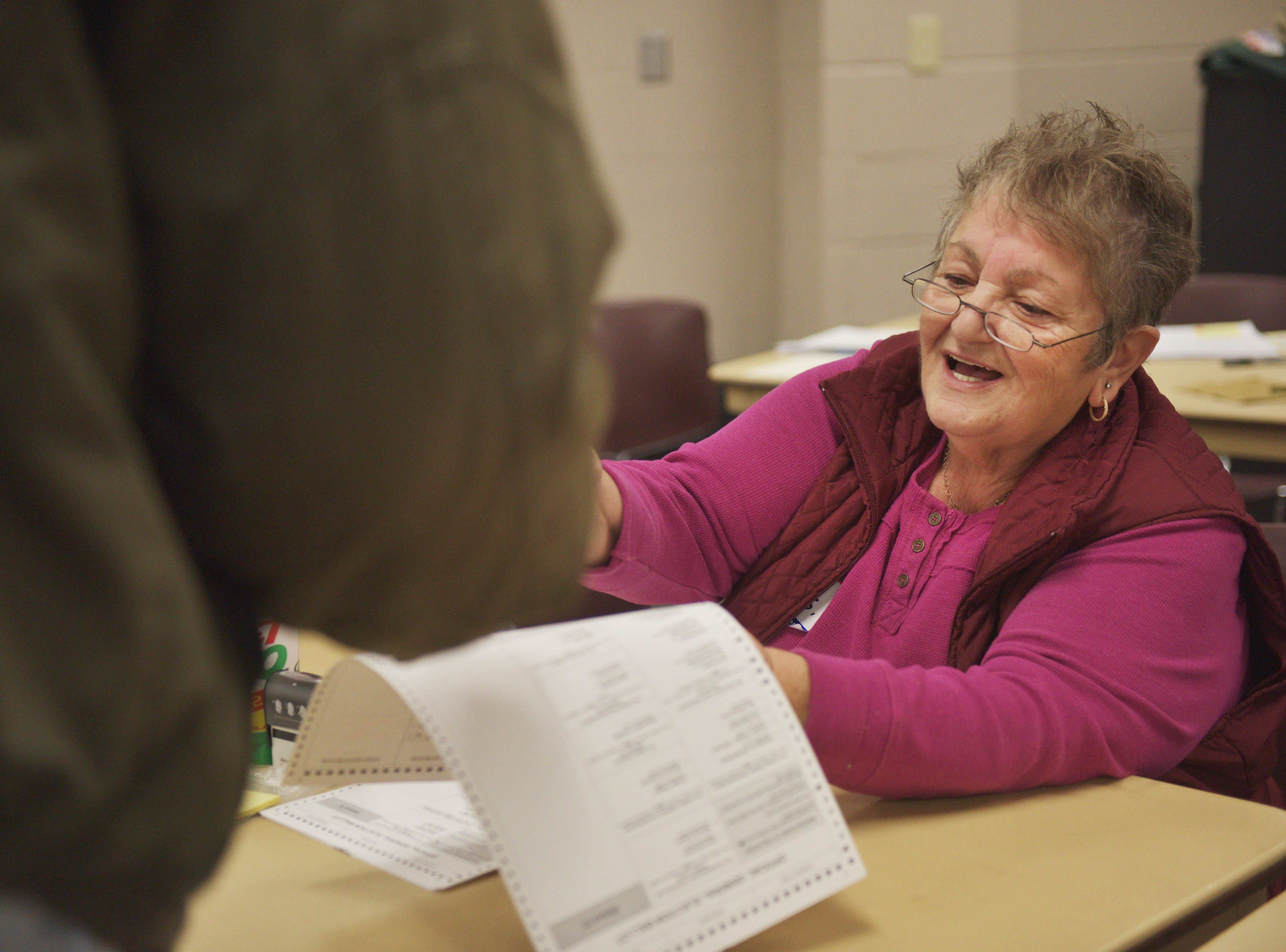 Poll worker Summer Stoll assists voters in the 2018 midterm elections Tuesday, Nov. 6, at First Lutheran Church in Sioux Falls.