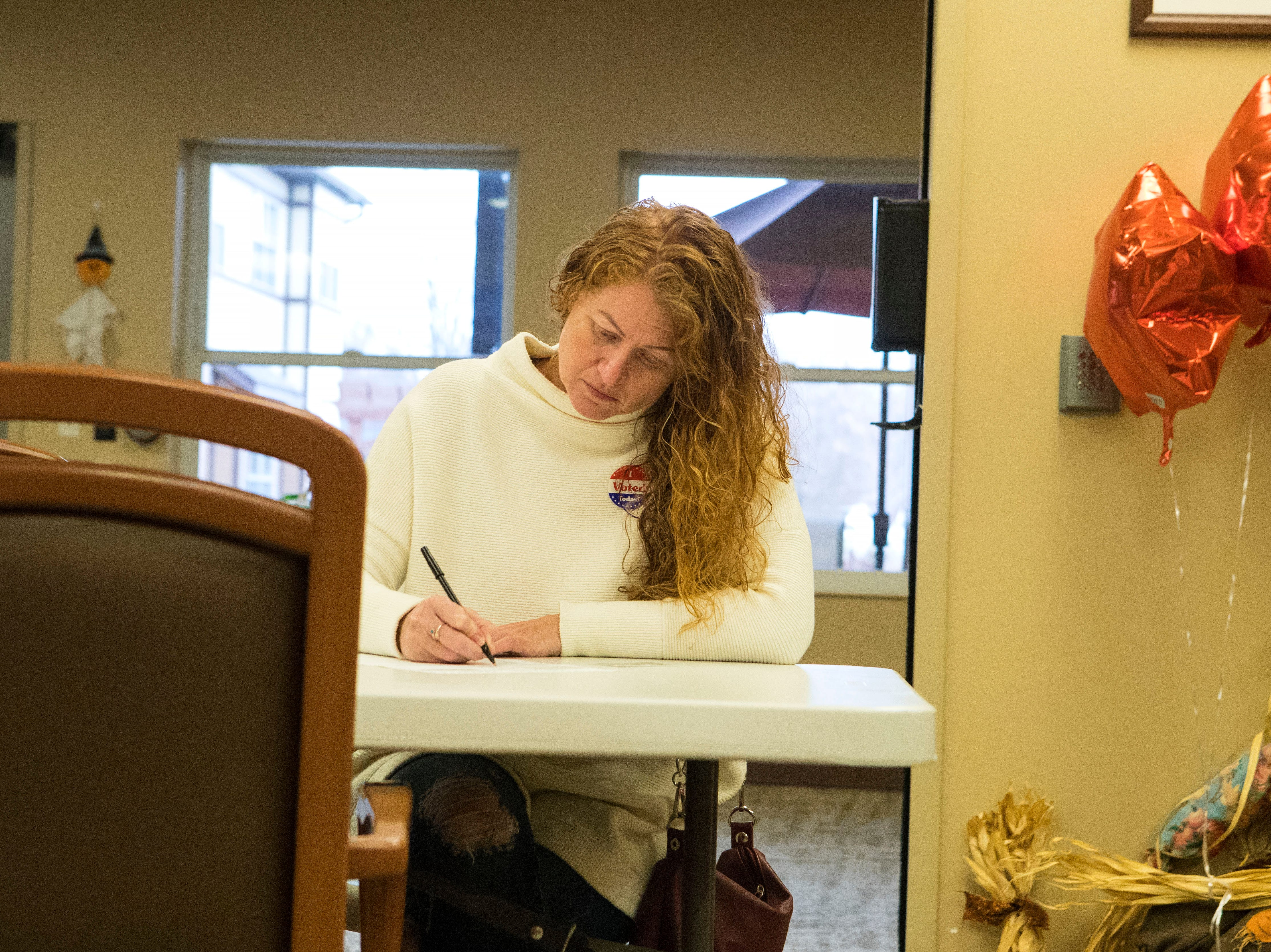 Sioux Falls resident fills out her ballot at Avera Prince of Peace Retirement Community in Sioux Falls, S.D., Tuesday, Nov. 6, 2018.