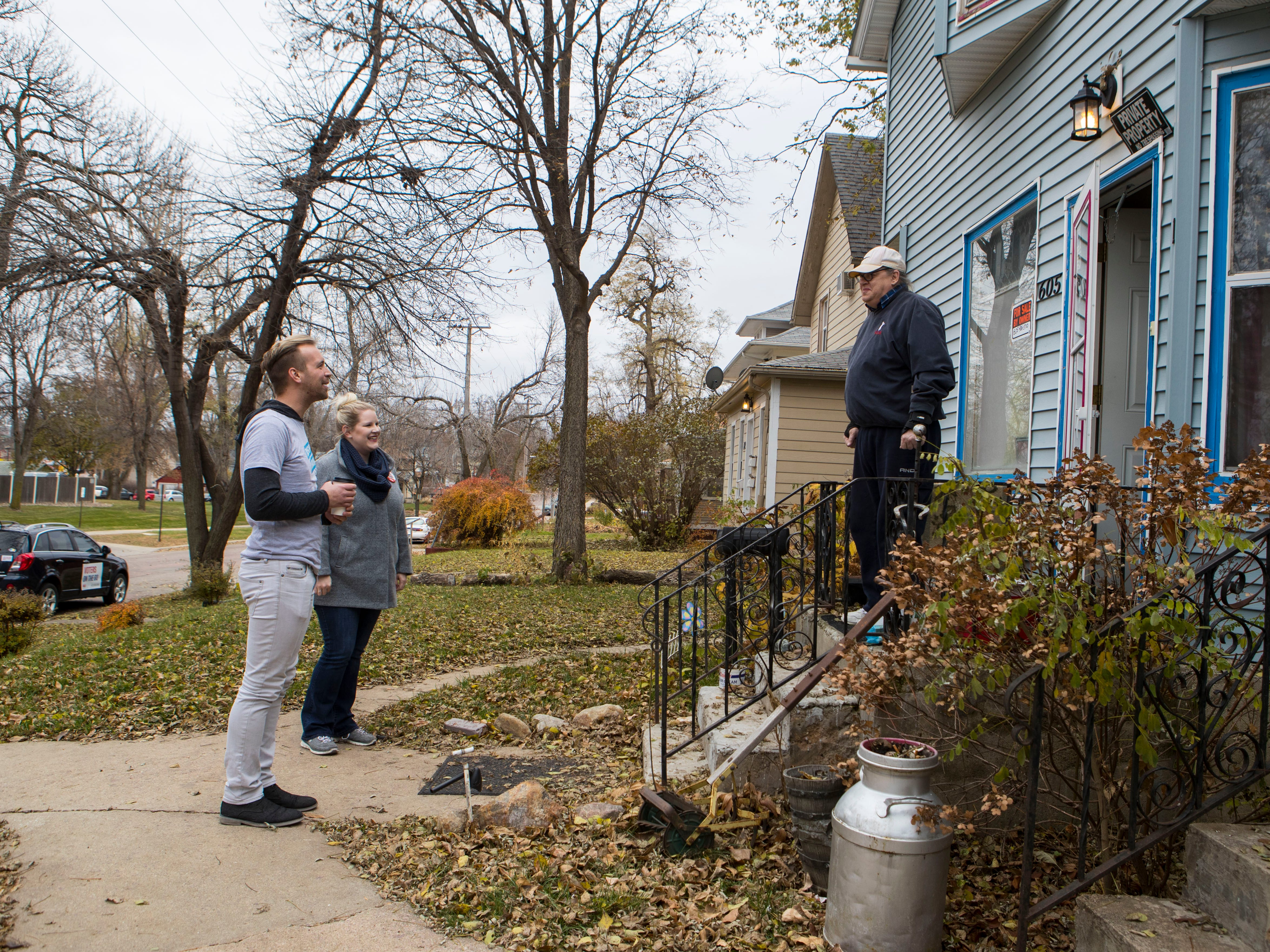 Luke Alton Huber and Kirsten Wichern, ACLU volunteers, pick up Larry Loebig (right) at his home and take him to First Lutheran Church, his voting center, in Sioux Falls, S.D., Tuesday, Nov. 6, 2018.