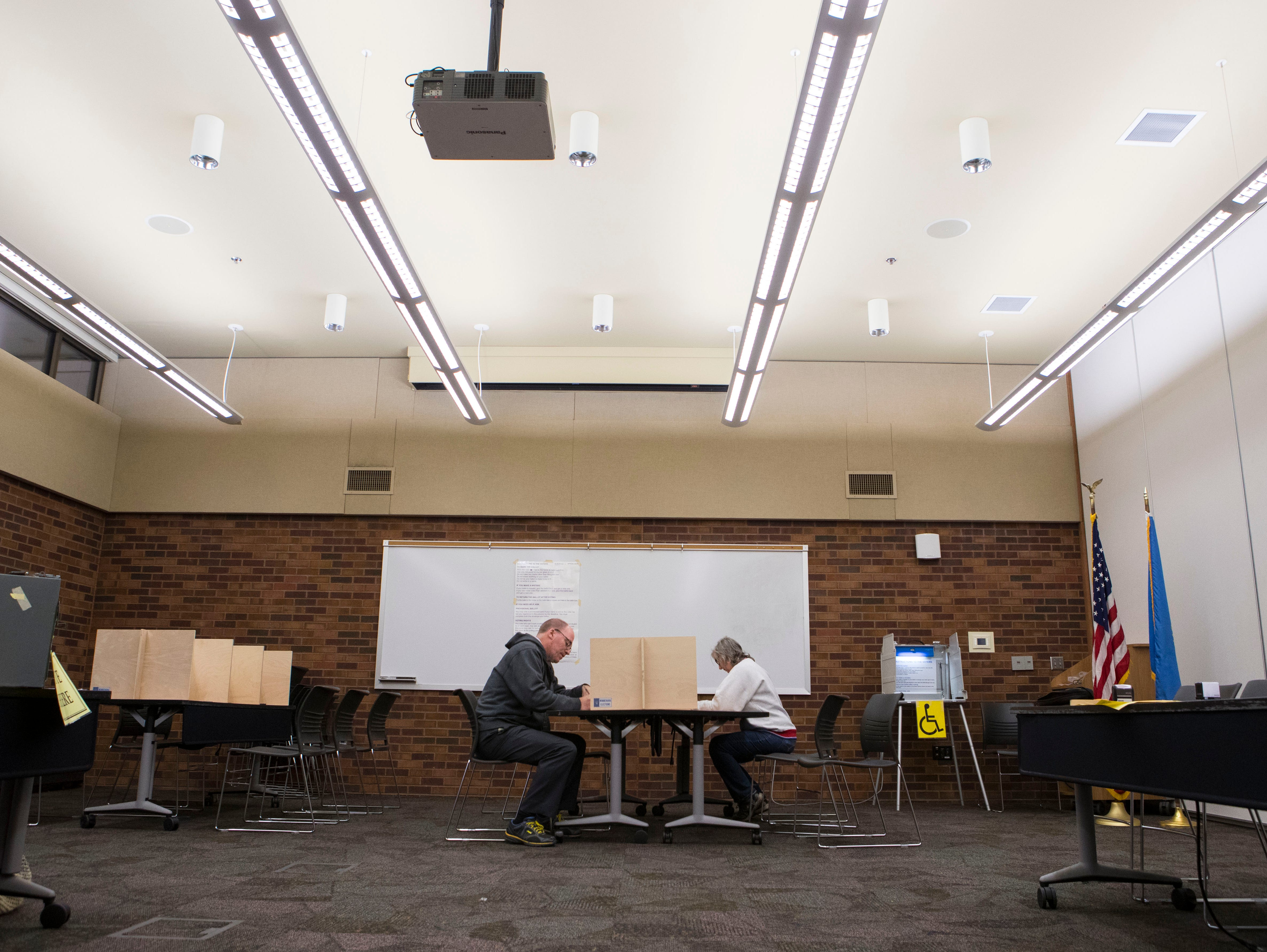 Sioux Falls residents fill out their ballots at the Downtown branch of the Siouxland Libraries in Sioux Falls, S.D., Tuesday, Nov. 6, 2018.