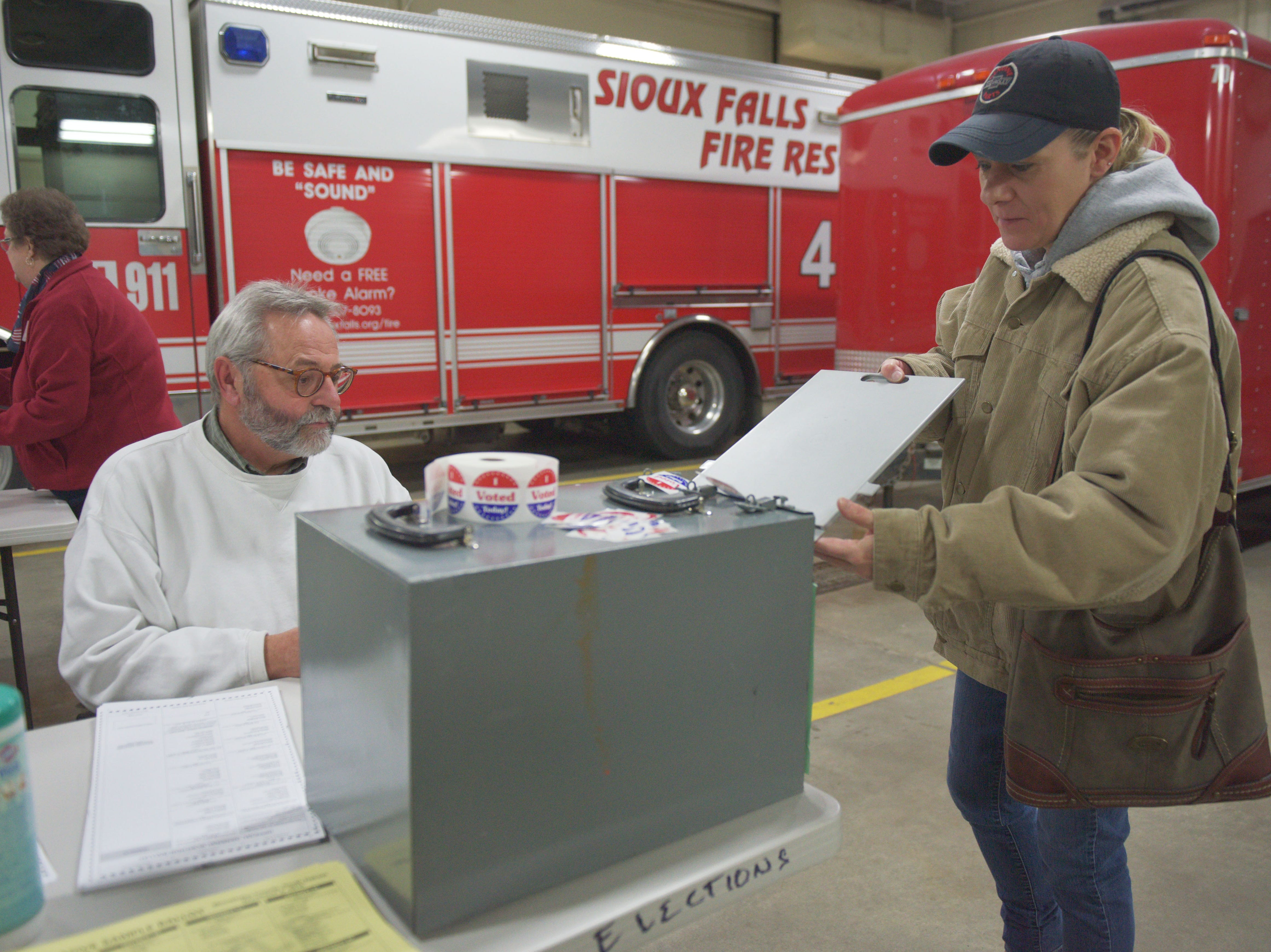 Melinda Meyer inserts her ballot for the 2018 midterm elections Tuesday, Nov. 6, at Fire Station #7 in Sioux Falls.