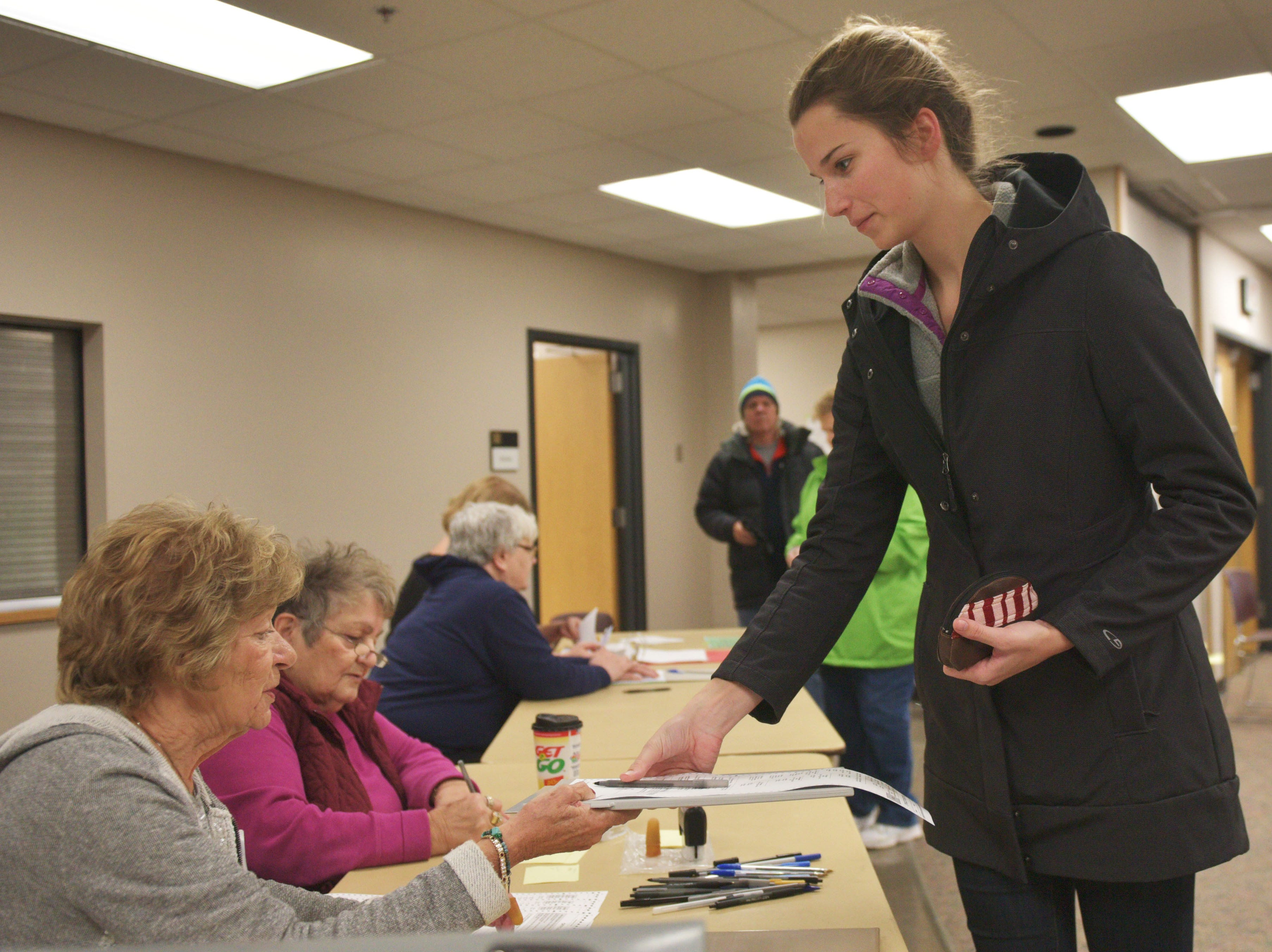 Maria Harrington receives her ballot for the 2018 midterm elections Tuesday, Nov. 6, at First Lutheran Church in Sioux Falls.