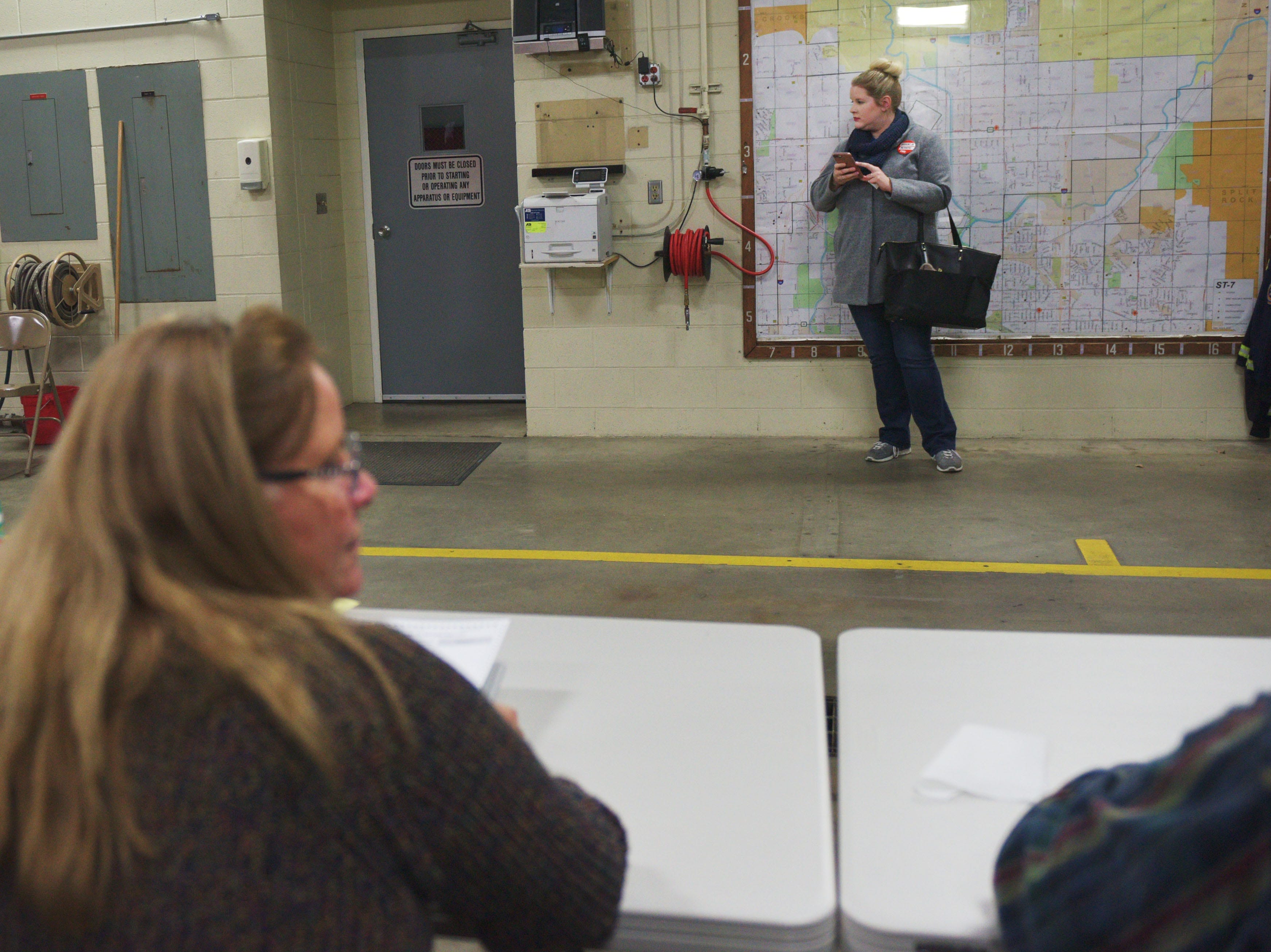 Kristen Wichern stands aside after she votes while waiting for her husband, Douglas, in the 2018 midterm elections Tuesday, Nov. 6, at Fire Station #7 in Sioux Falls.