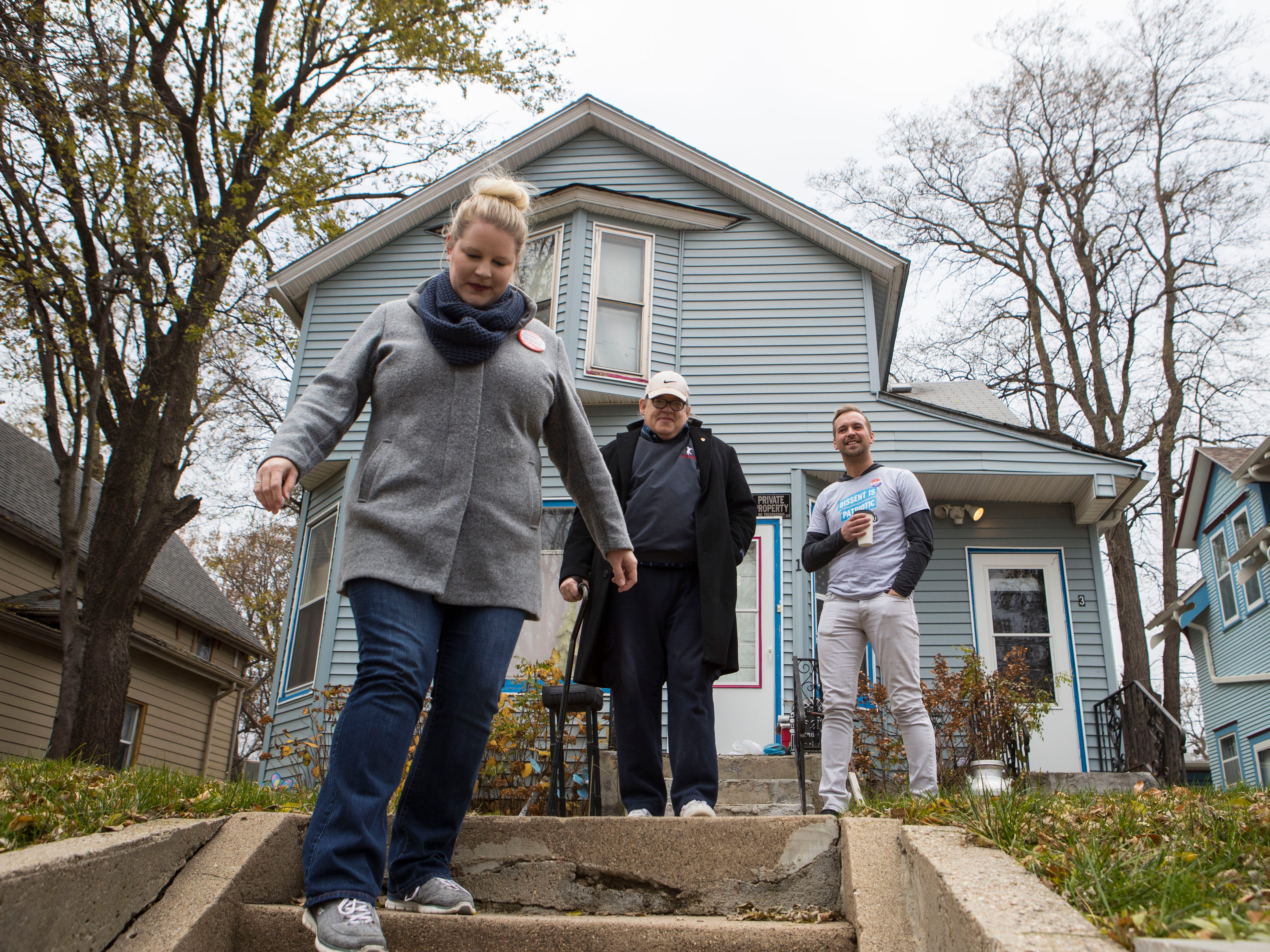 Luke Alton Huber and Kirsten Wichern, ACLU volunteers, pick up Larry Loebig (center) at his home and take him to First Lutheran Church, his voting center, in Sioux Falls, S.D., Tuesday, Nov. 6, 2018.