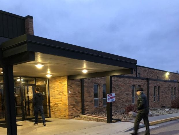 Voters arrive early to vote at Sioux Falls First Church.