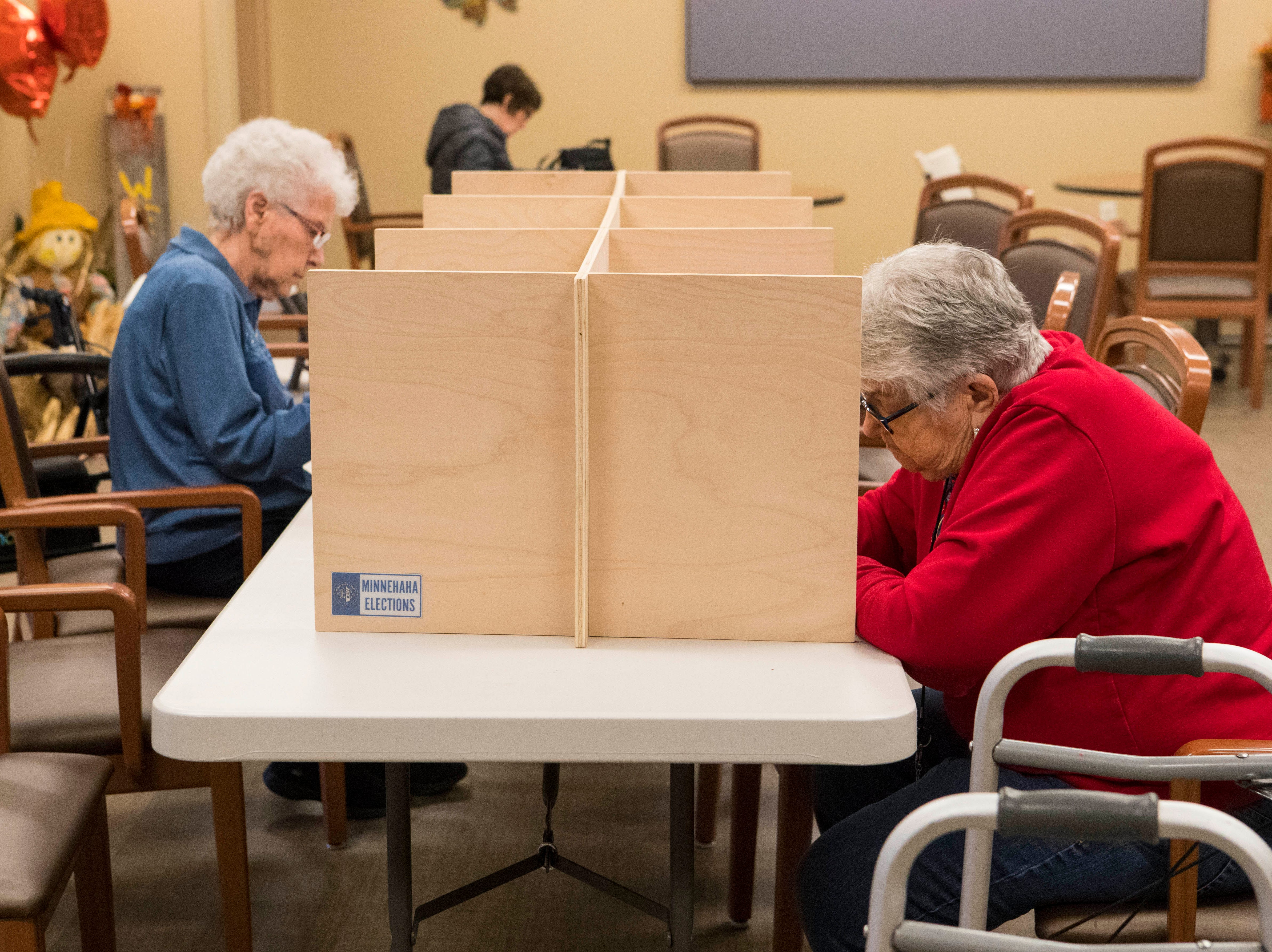 Voters fill out their ballots at Avera Prince of Peace Retirement Community in Sioux Falls, S.D., Tuesday, Nov. 6, 2018.