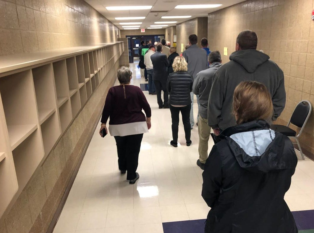 Voters stand in line at Harvey Dunn/Morningside to vote Tuesday morning.