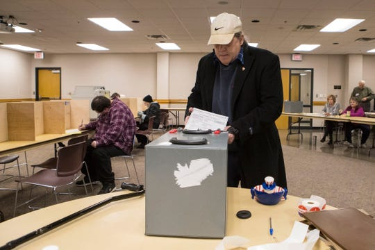 Larry Loebig casts his ballot at First Lutheran Church in Sioux Falls, S.D., Tuesday, Nov. 6, 2018.