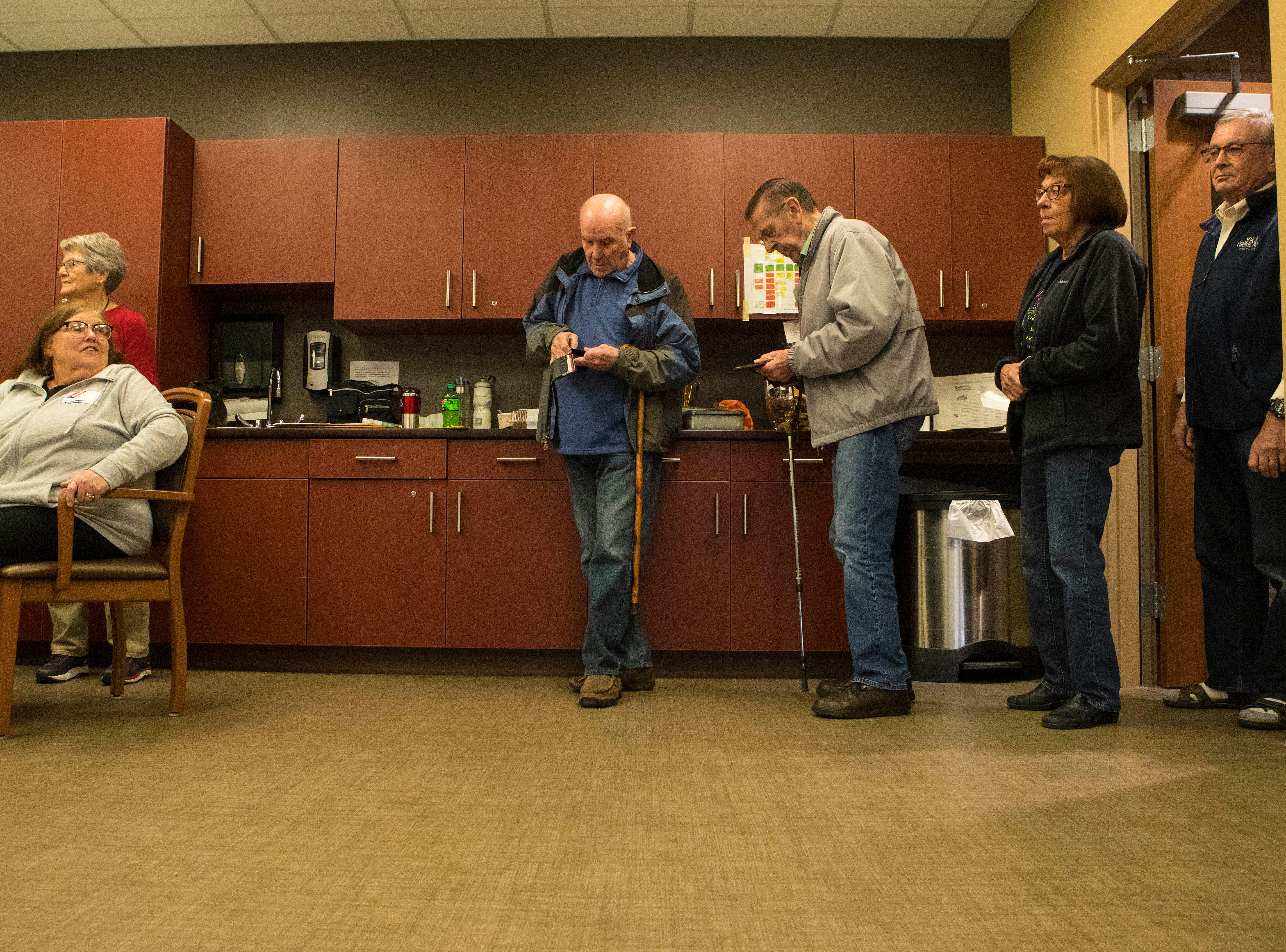 Sioux Falls residents wait in line to vote at Avera Prince of Peace Retirement Community in Sioux Falls, S.D., Tuesday, Nov. 6, 2018.
