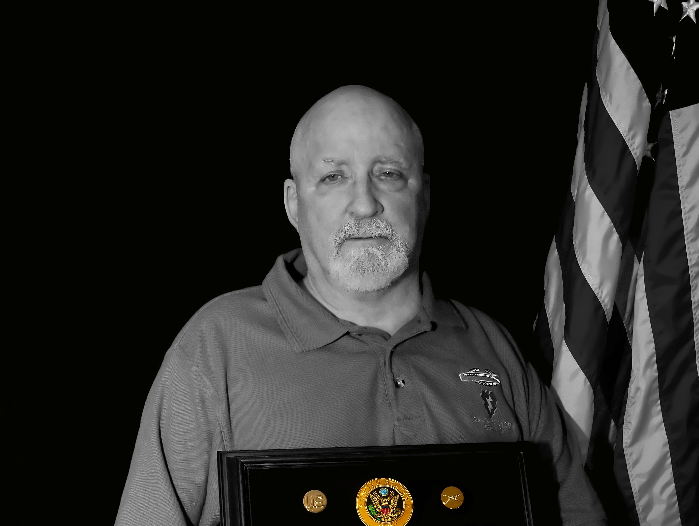 Dave Cauley of Larchwood, Iowa, poses for a photograph with the medals and stripes he earned while serving in the Vietnam War.