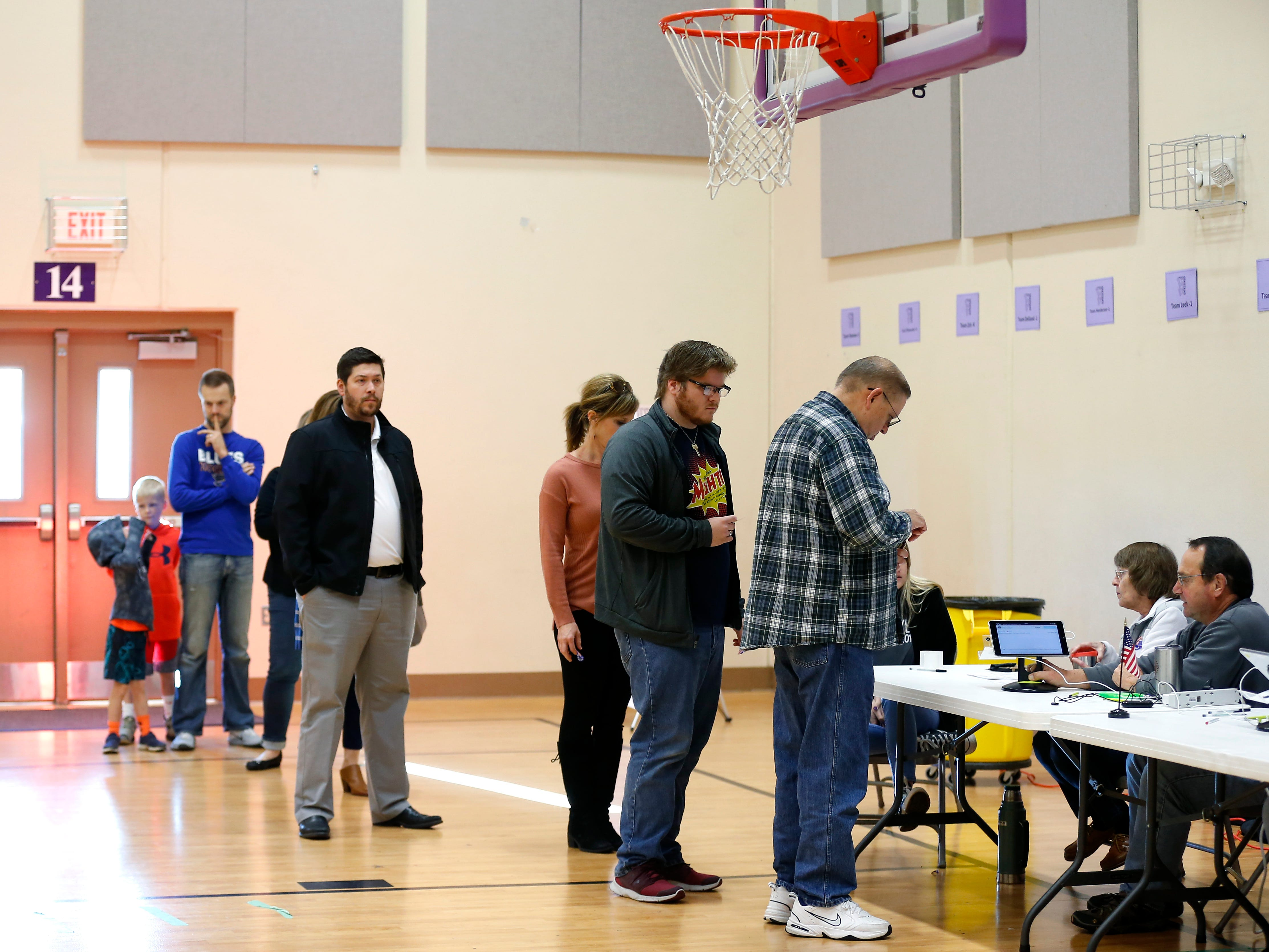 Voters line up to vote at the Hickory Hills School polling location on Tuesday, Nov. 6, 2018.