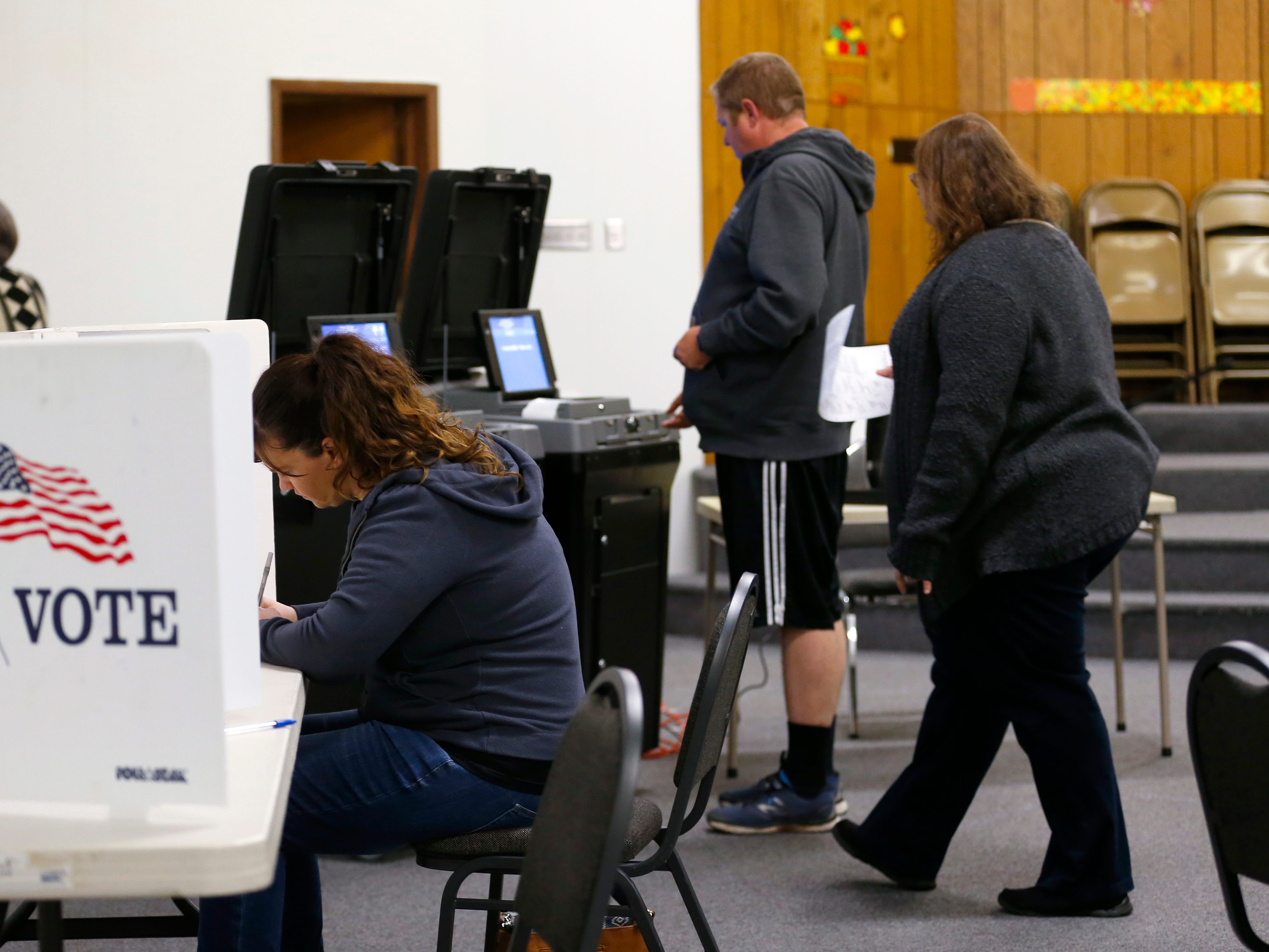 Lisa Silver casts her ballot at the Springfield Bible Church polling location on Tuesday, Nov. 6, 2018.
