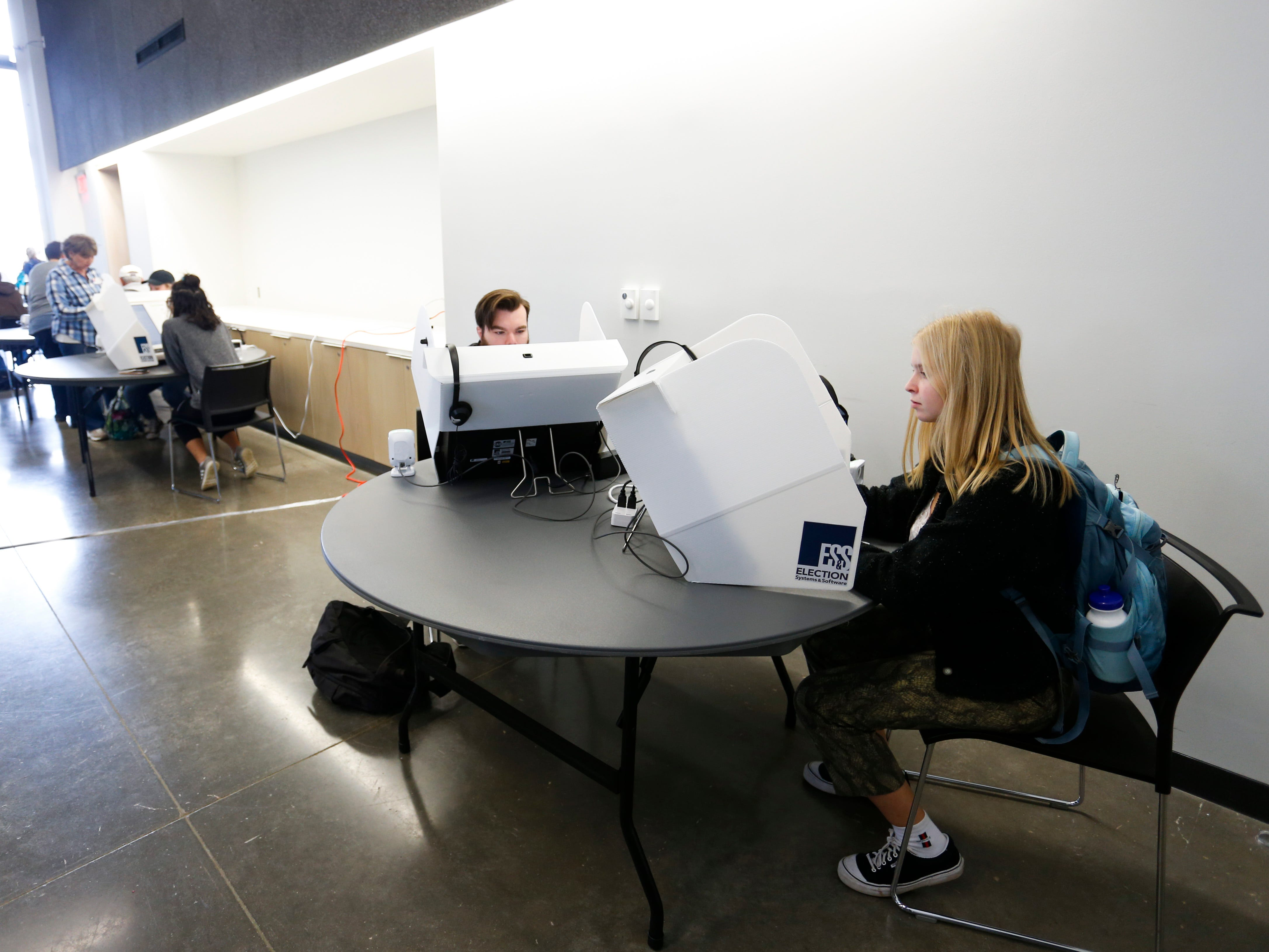 First time voter Kaylinn Cloffelter, 18, uses an electronic voting machine to cast her ballot at the Missouri State University Davis-Harrington Welcome Center on Tuesday, Nov. 6, 2018.
