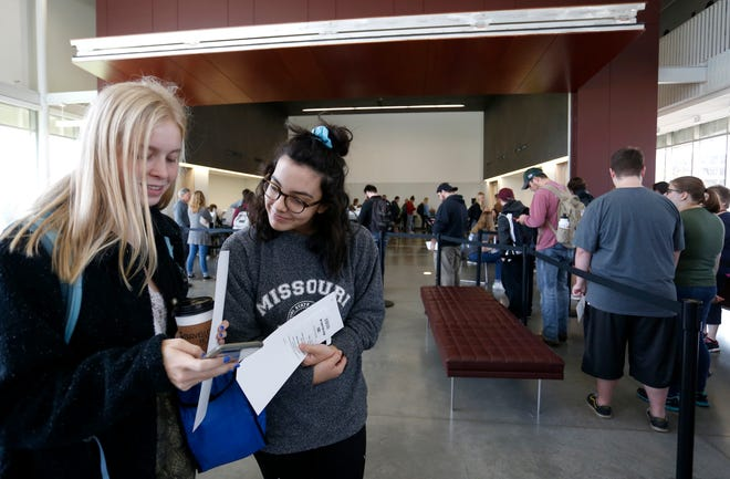 Missouri State students and first time voters Kaylinn Cloffelter (left), 18, and Audrey Broyles, 18, research candidates and amendments on the ballot while waiting in line to vote at the Missouri State University Davis-Harrington Welcome Center on Tuesday, Nov. 6, 2018.