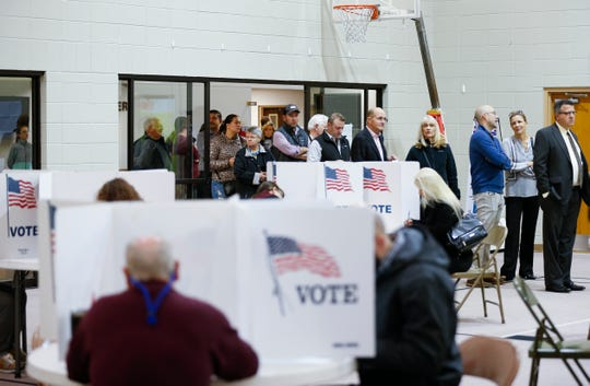 Voters line up at the East Sunshine Church of Christ to cast their ballots on Tuesday, Nov. 6, 2018.