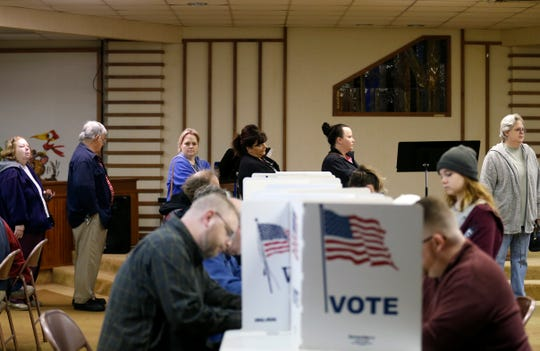 Voters wait in line to fill out ballots at the Woodland Heights polling location on Tuesday, Nov. 6, 2018.