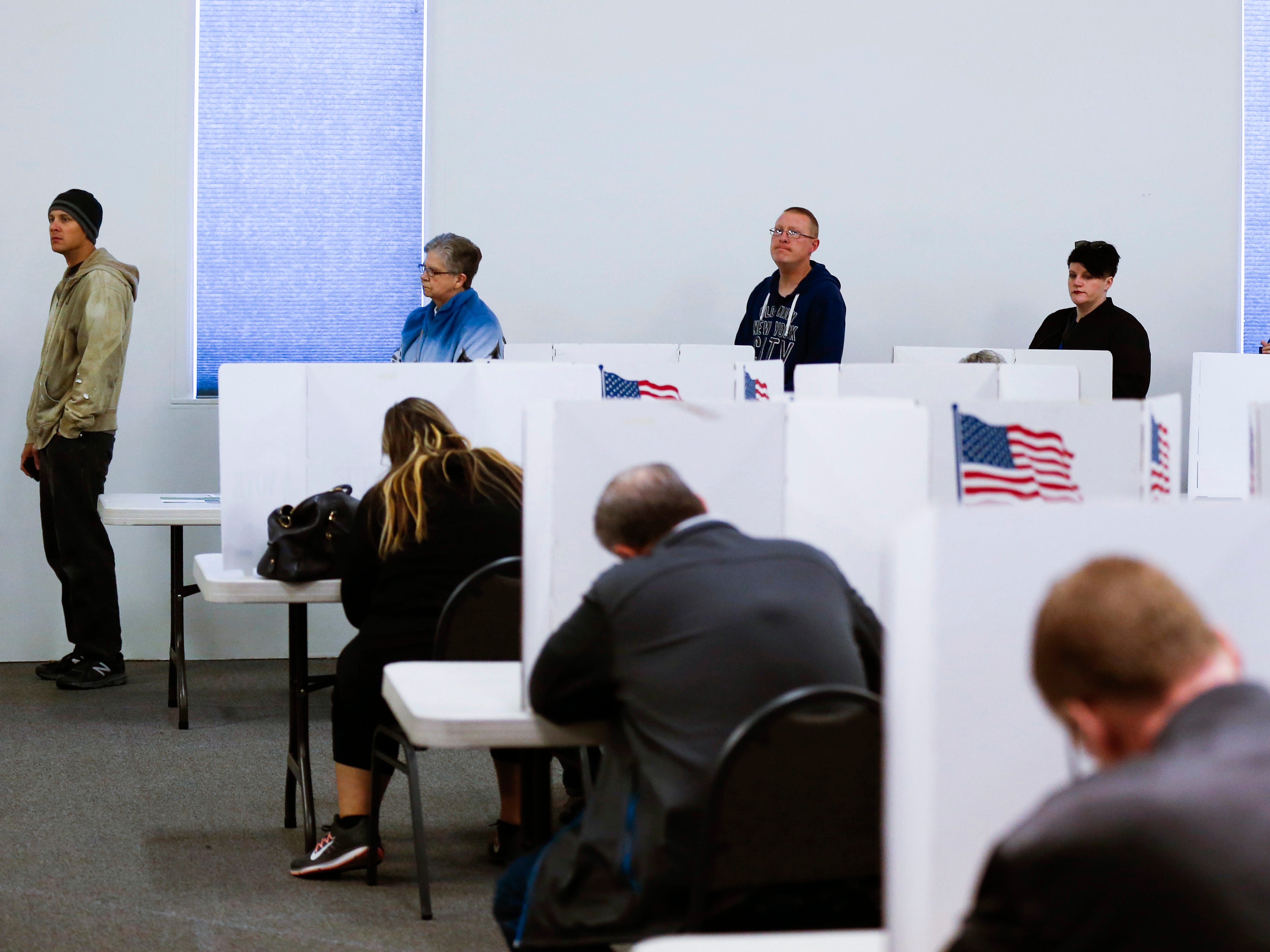 Voters cast their ballots at the Springfield Bible Church polling location on Tuesday, Nov. 6, 2018.