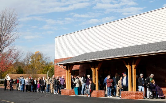 Voters line up at the Berean Baptist Church to cast their ballots on Tuesday, Nov. 6, 2018.