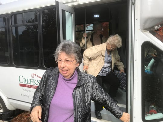 "Cathy Carleton, 69, is well informed on the issues. As she boarded the bus, she said, ""Hello all you patriots!"""