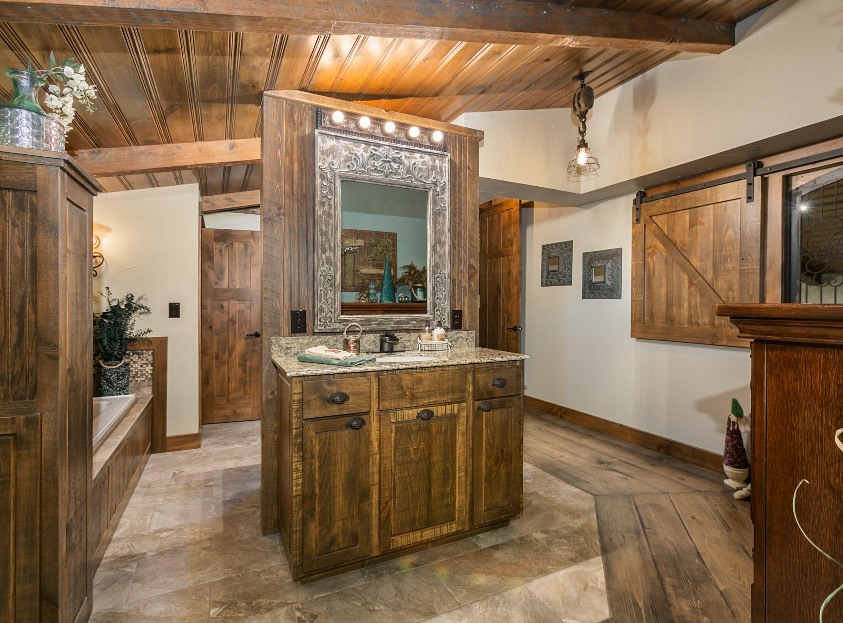 A spare bedroom was transformed into a spacious master bath suite.