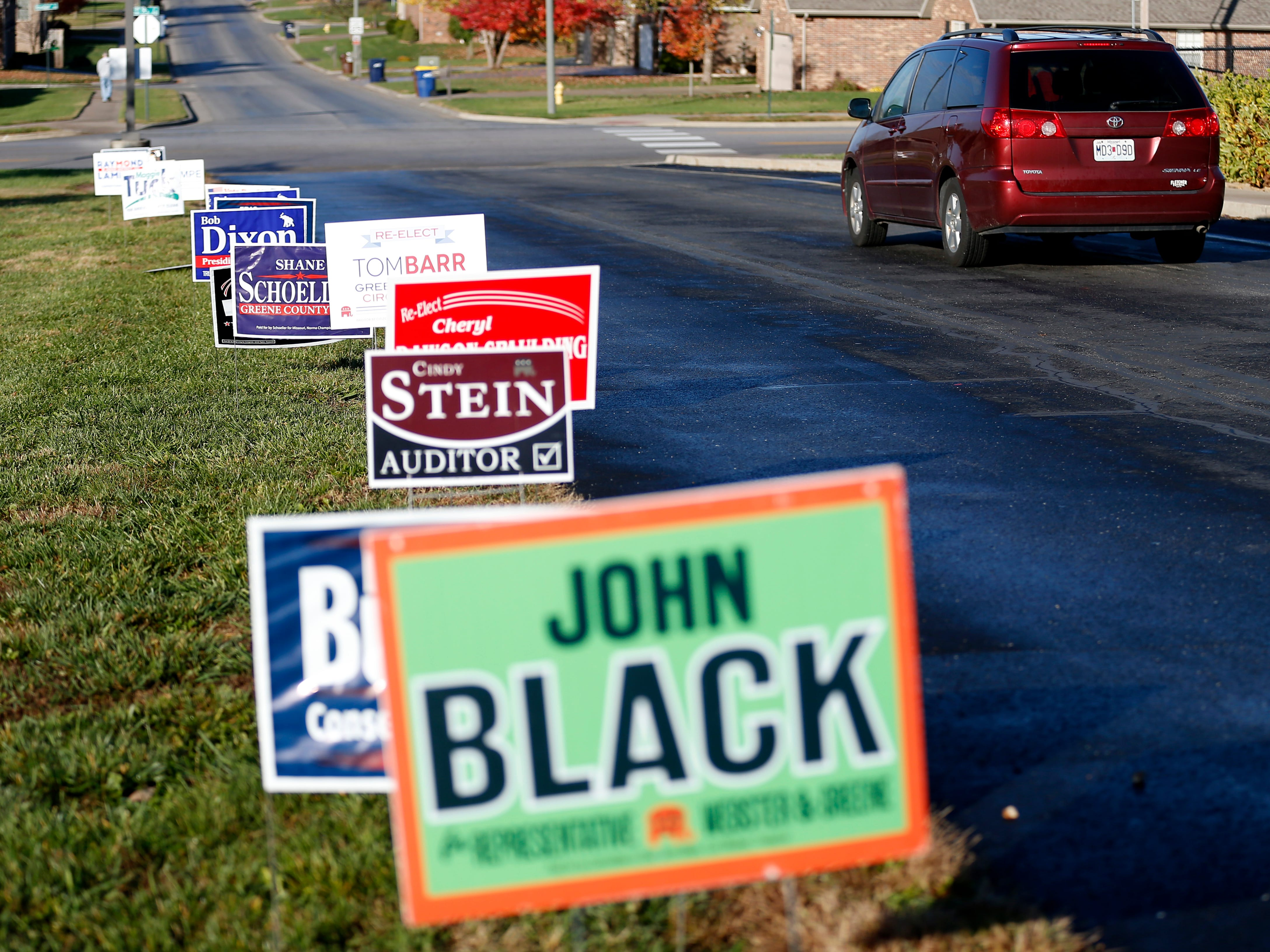 political signs line the driveway to the Hickory Hills School polling location on Tuesday, Nov. 6, 2018.