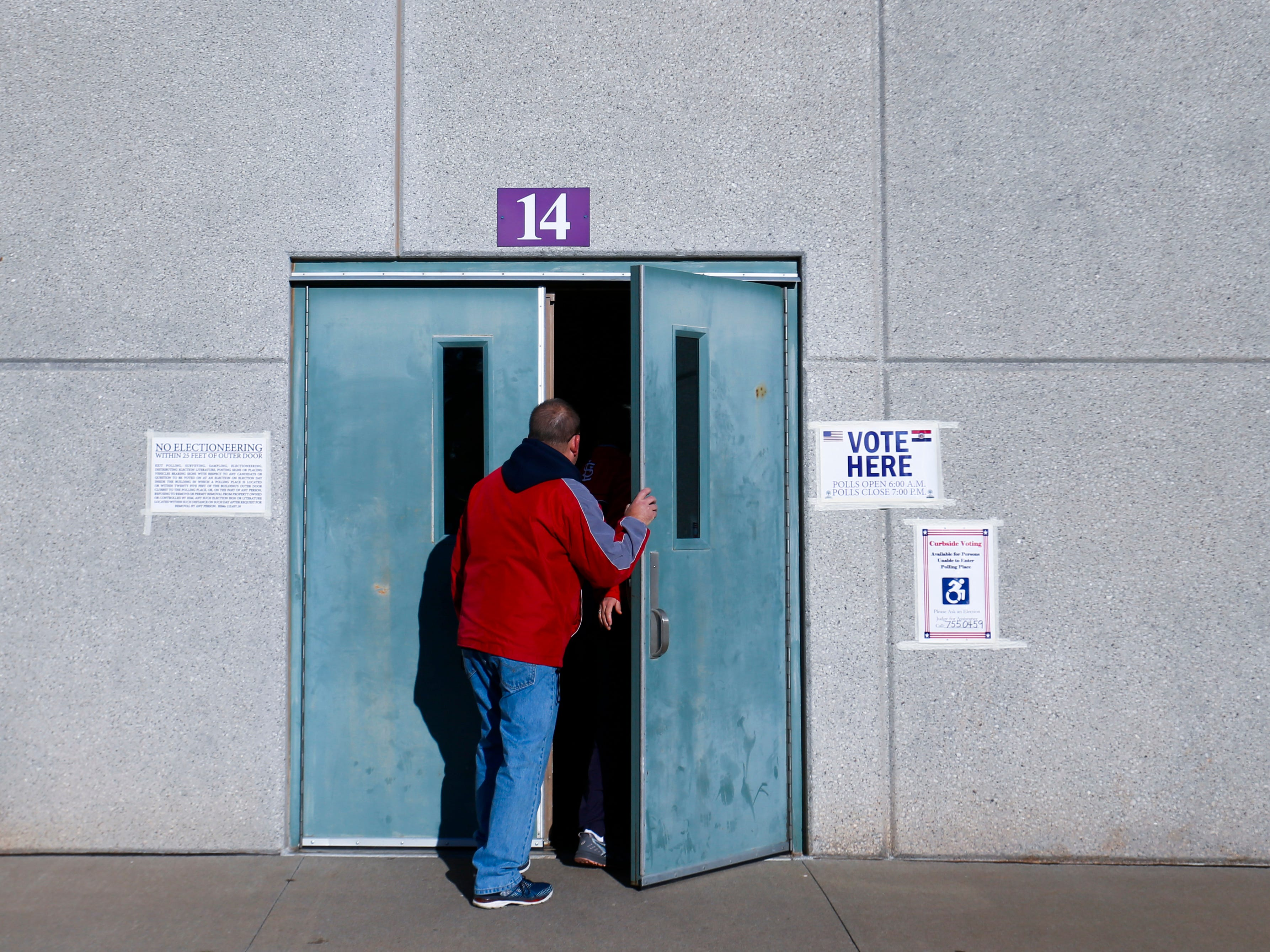 A voter enters the Hickory Hills School polling location on Tuesday, Nov. 6, 2018.