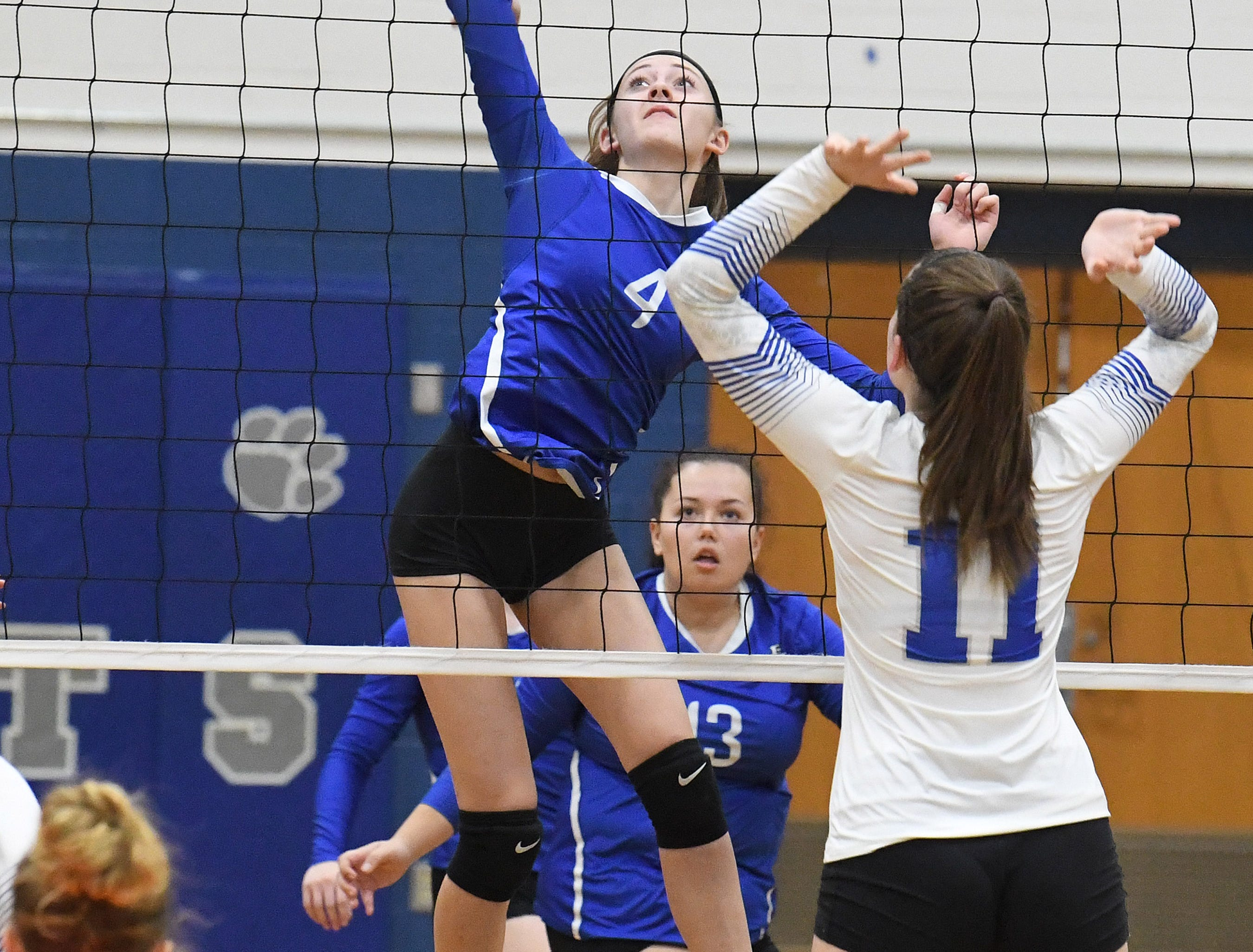Fort Defiance's Leilani Goggin draws back to spike the ball during a Region 3C semifinal match played in Lexington on Monday, Nov. 5, 2018.