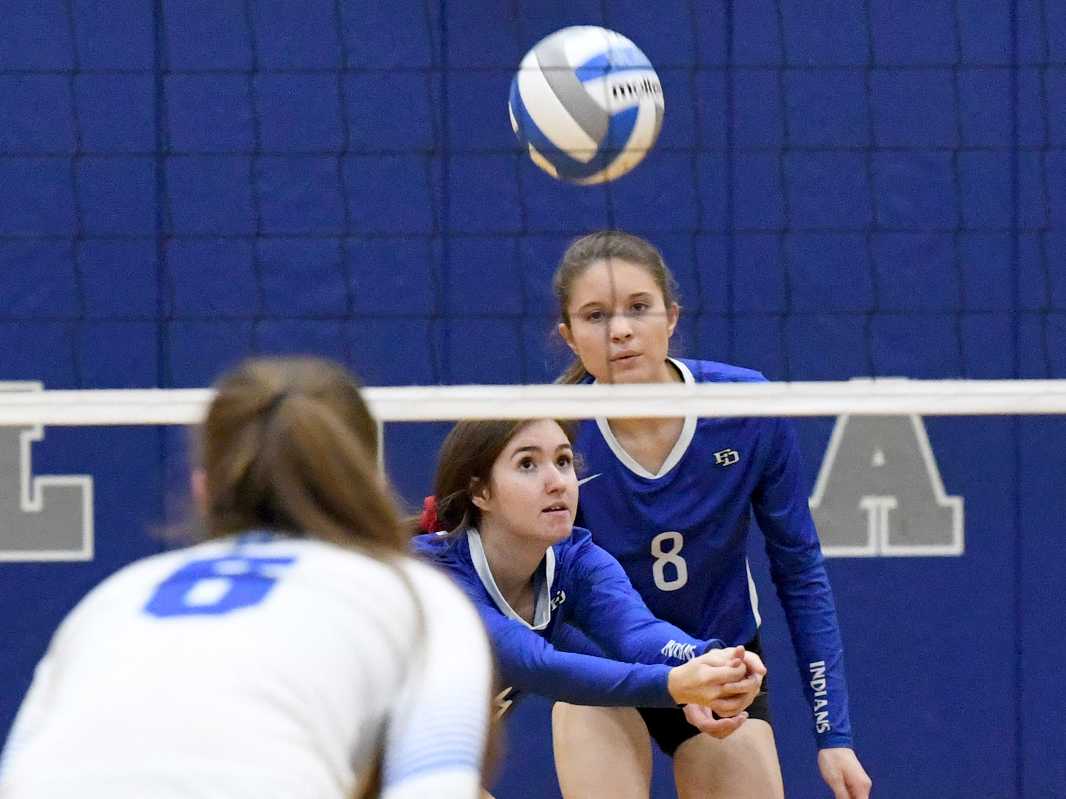 A Fort Defiance player bumps the ball to keep it in the air as Fort's Casey Mozingo watches during a Region 3C semifinal match played in Lexington on Monday, Nov. 5, 2018.
