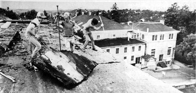Staunton Leader photo of W.A. Botkin, Troy Johnson and Frank Johnson ripping up the roof of North Barracks in June 1982. By summer's end, the historic SMA structure was just a memory.
