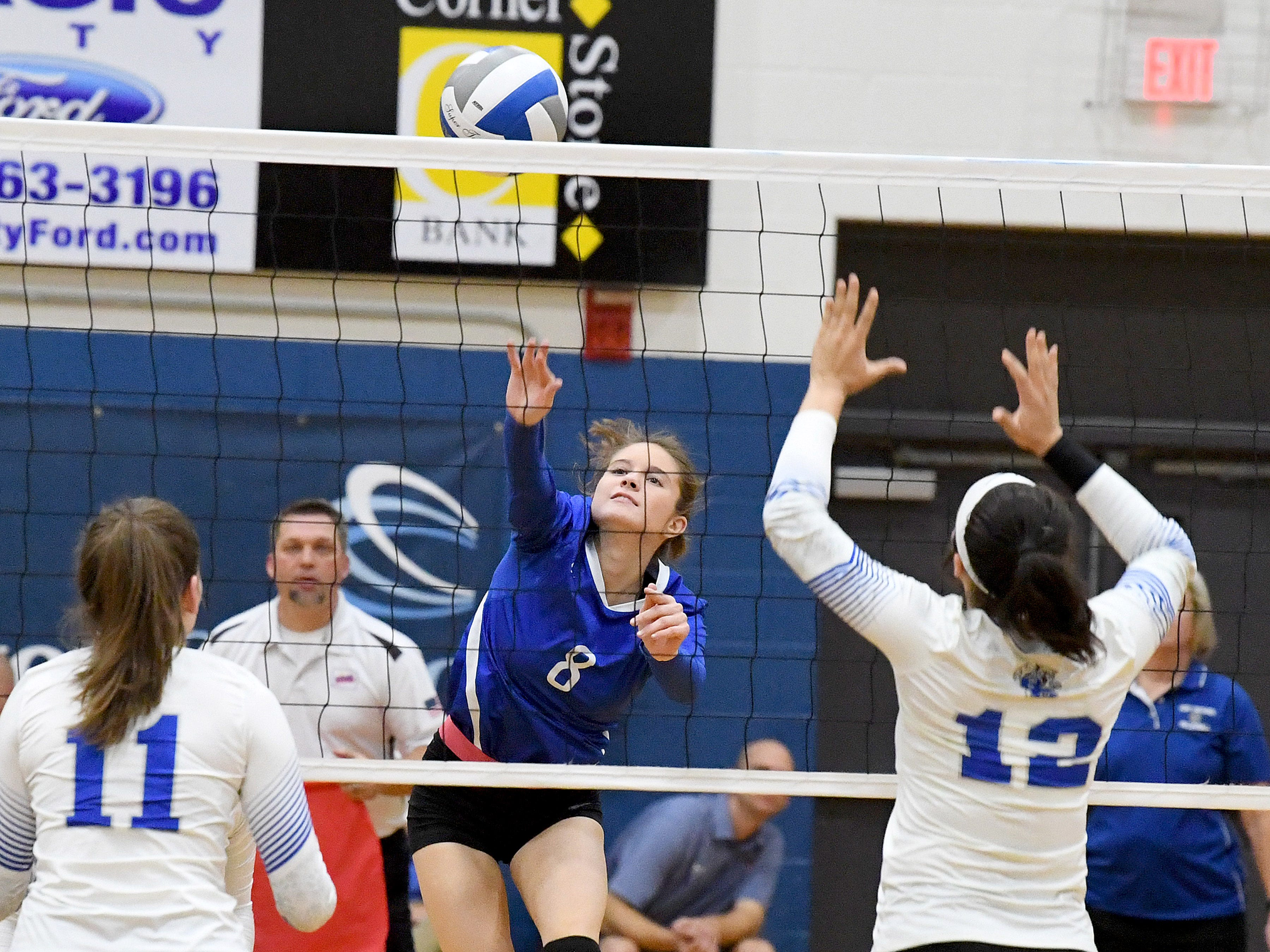 Fort Defiance's Emma Lawson sends the ball back across the net during a Region 3C semifinal match played in Lexington on Monday, Nov. 5, 2018.