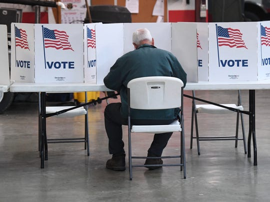A resident fills out a ballot at the Lyndhurst precinct at the Wilson Volunteer Fire Department on Nov. 6, 2018.