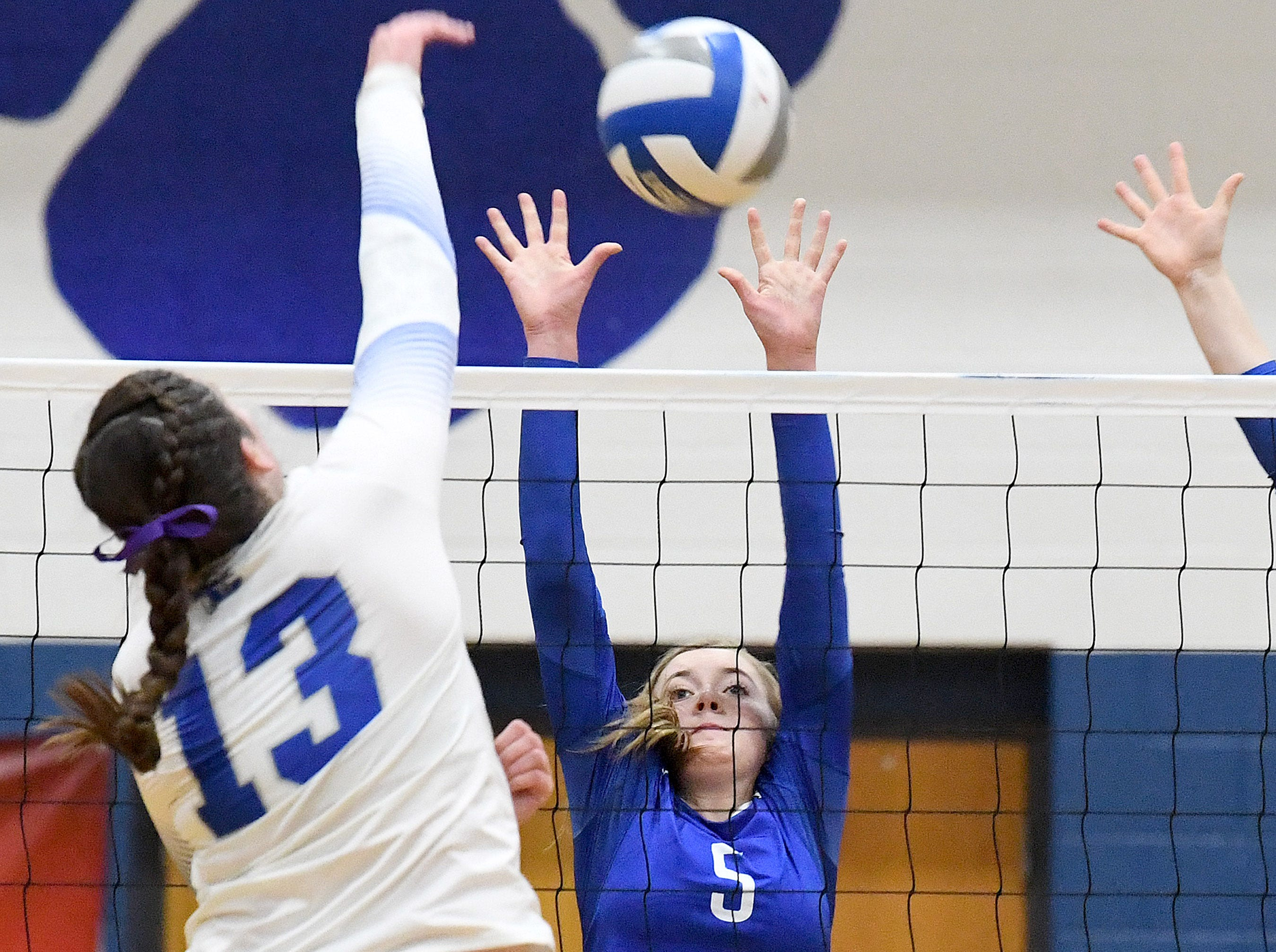 Fort Defiance's Madison Painter tries to block a return by Rockbridge County's Graceon Armstrong during a Region 3C semifinal match played in Lexington on Monday, Nov. 5, 2018.