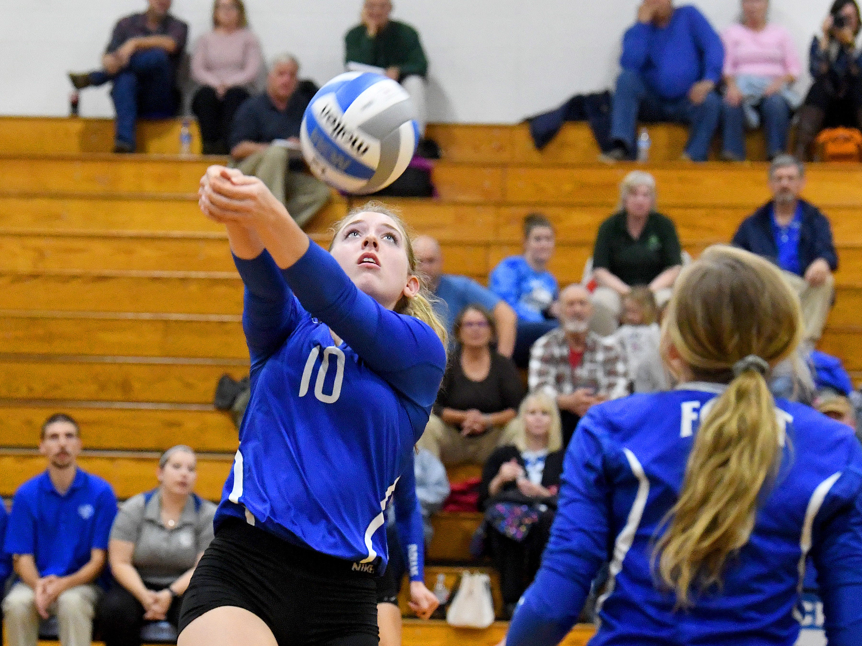 Fort Defiance's Catie Cramer bumps the ball during a Region 3C semifinal match played in Lexington on Monday, Nov. 5, 2018.