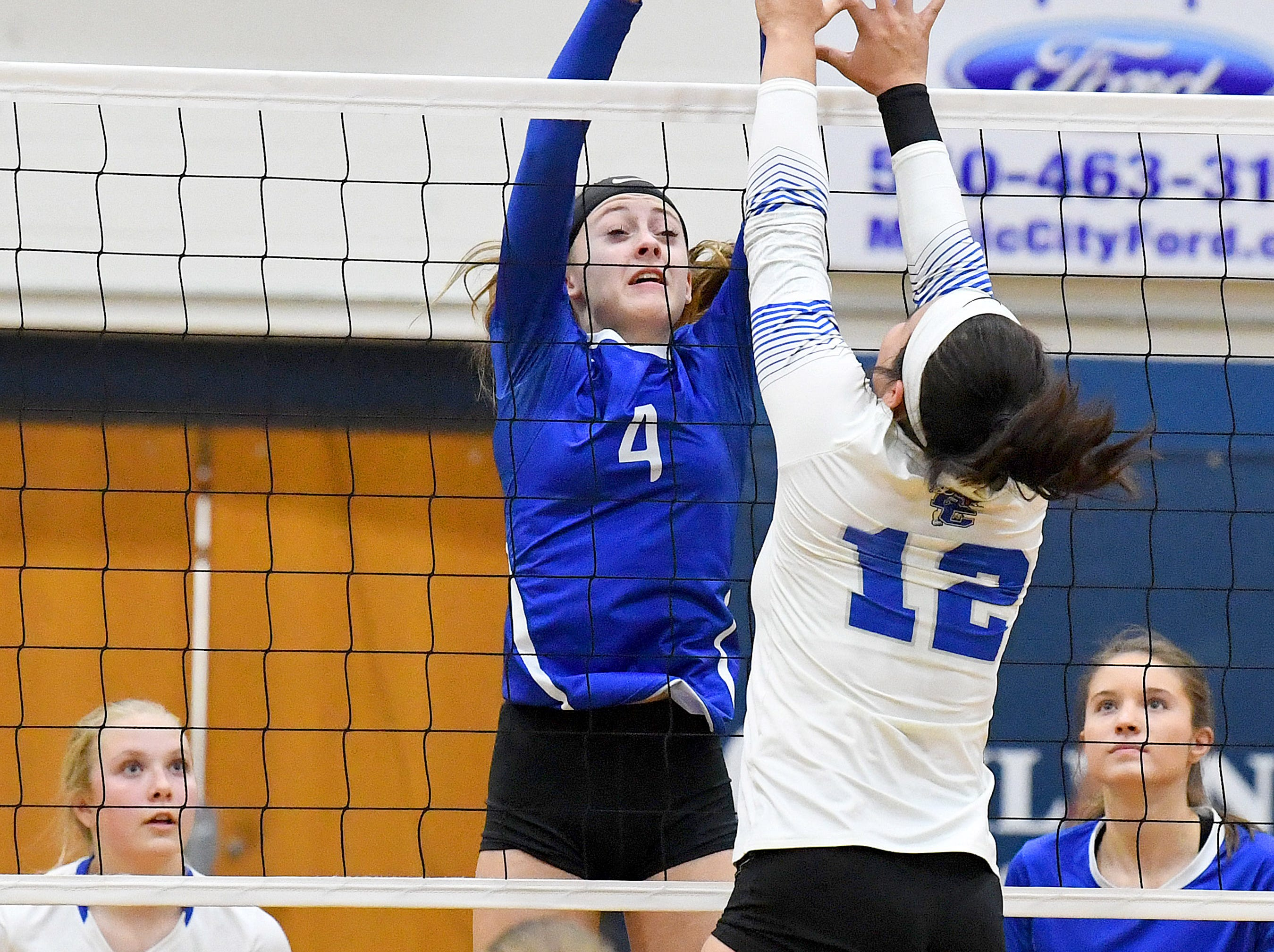 Fort Defiance's Leilani Goggin sends the ball back cross the net as Rockbridge County's Jaden Harrison tries to block at the net during a Region 3C semifinal match played in Lexington on Monday, Nov. 5, 2018.