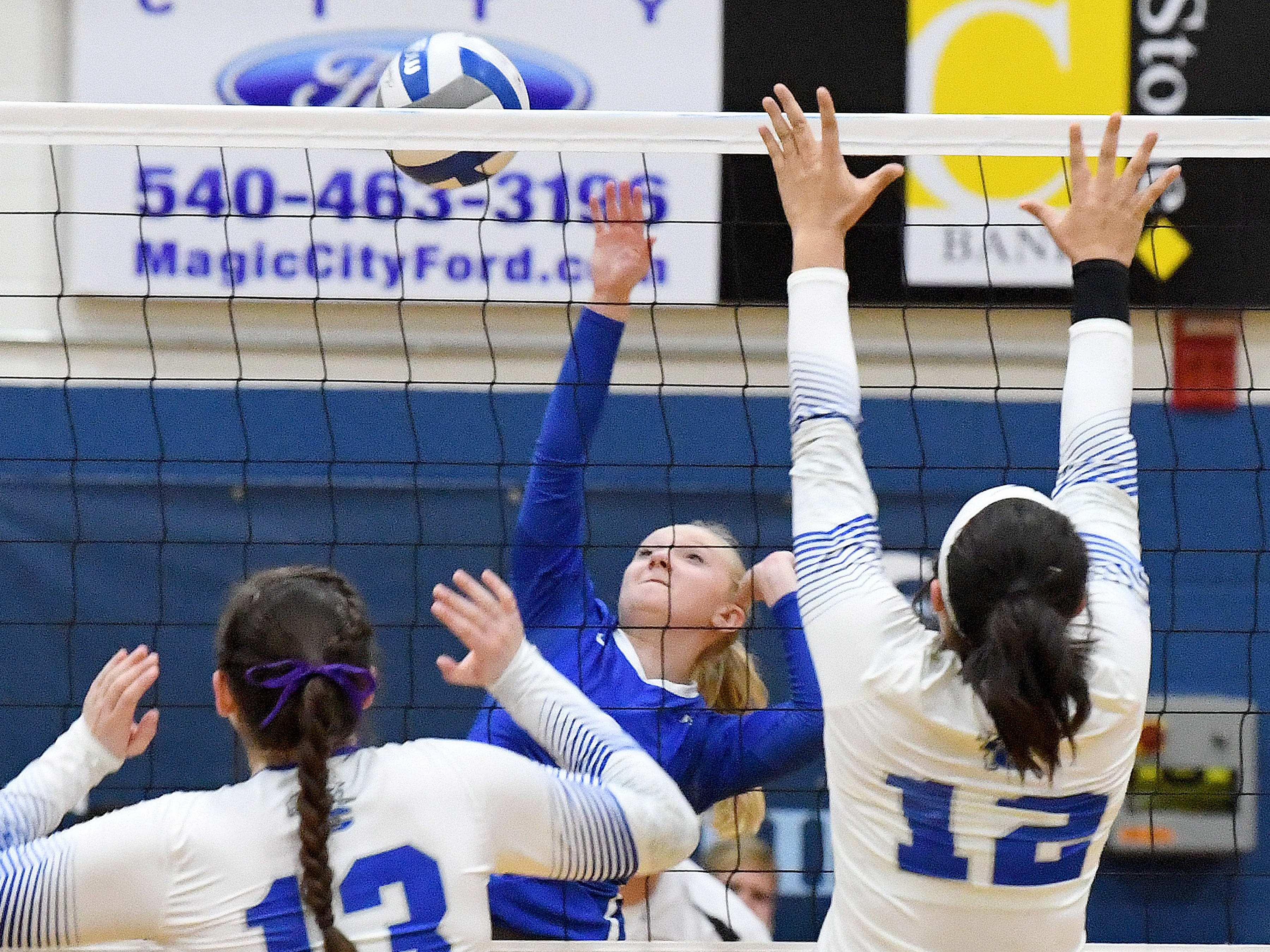 Fort Defiance's Ashley Humphries spikes the ball back across the net during a Region 3C semifinal match played in Lexington on Monday, Nov. 5, 2018.