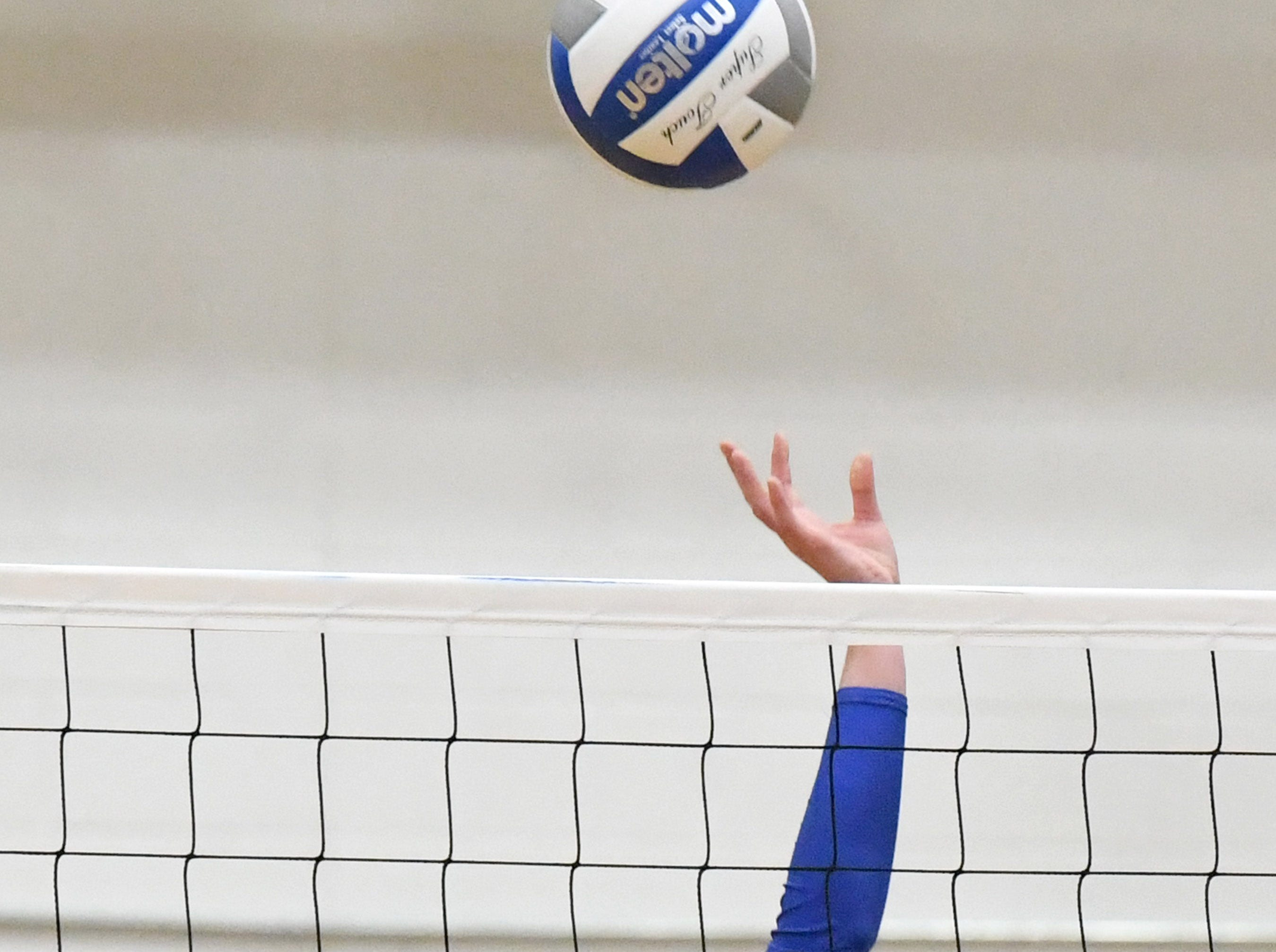 Fort Defiance's Madison Painter sends the ball back across the net during a Region 3C semifinal match played in Lexington on Monday, Nov. 5, 2018.