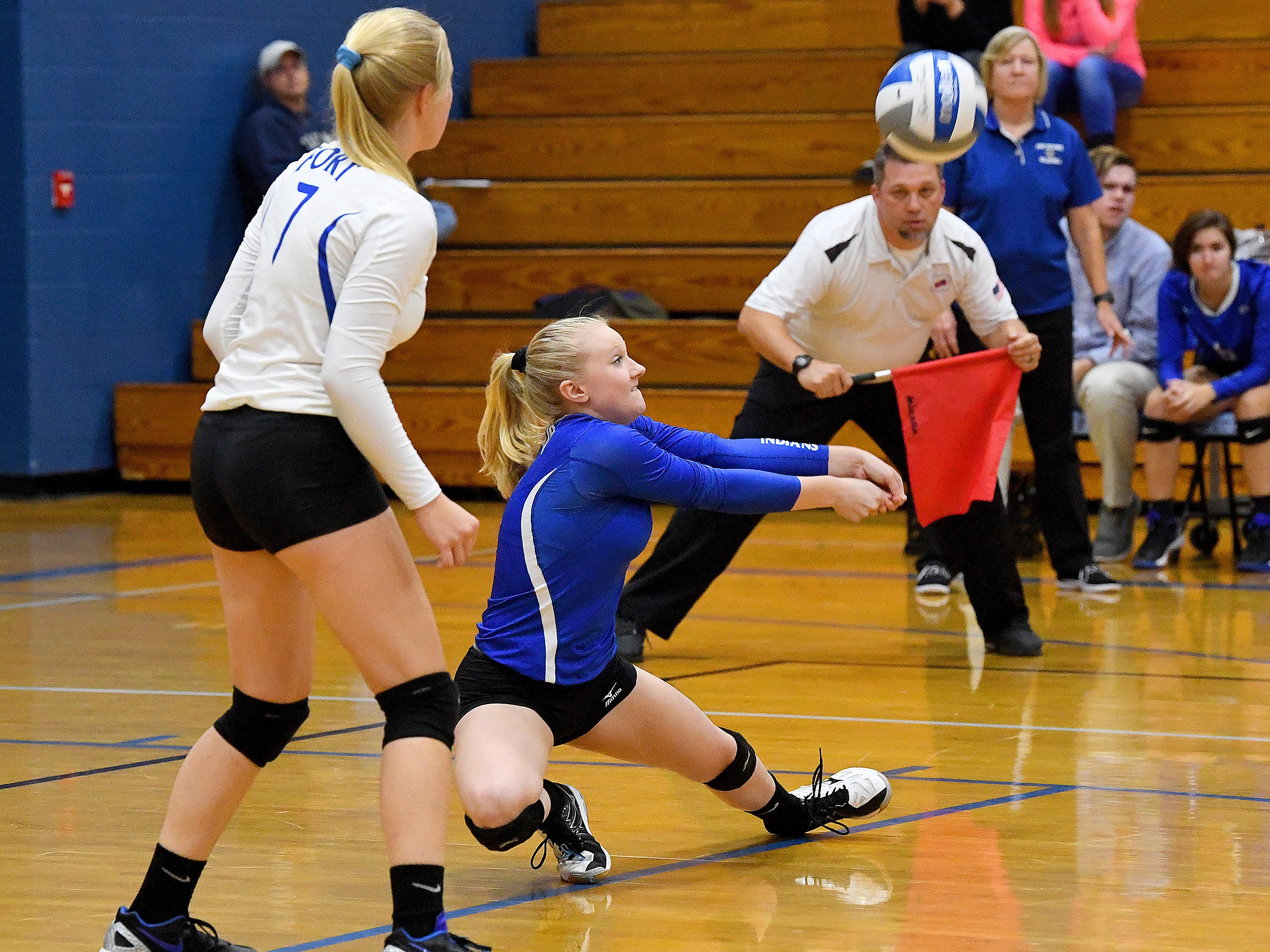 Fort Defiance's Ashley Humphries drops low to bump the ball during a Region 3C semifinal match played in Lexington on Monday, Nov. 5, 2018.