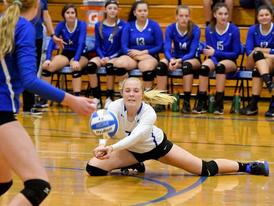 Fort Defiance's Jordan Schulz dives down to bump the ball and keep it in play during a Region 3C semifinal match played in Lexington on Monday, Nov. 5, 2018.