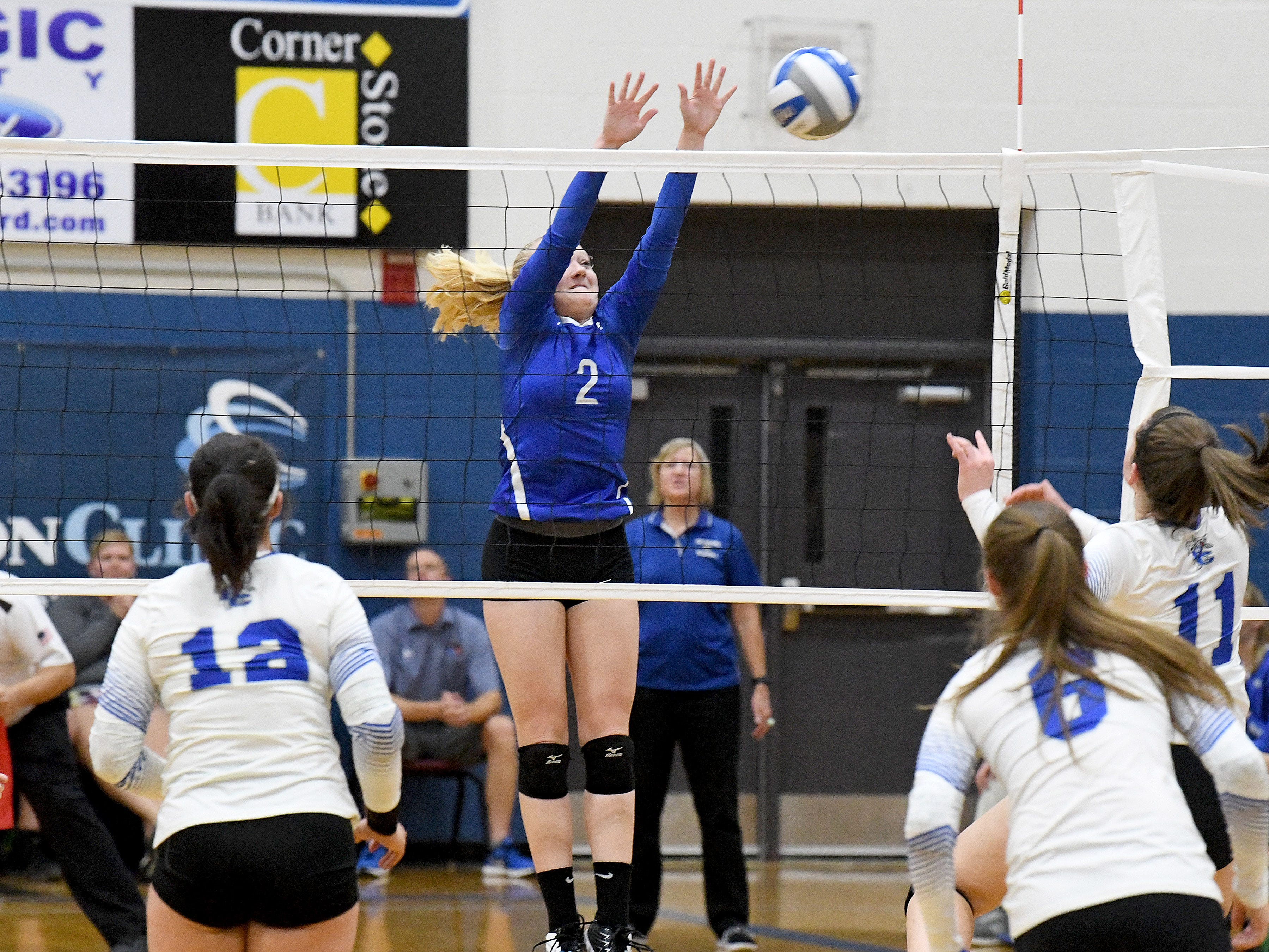 Fort Defiance's Ashley Humphries tries to block a return at the net during a Region 3C semifinal match played in Lexington on Monday, Nov. 5, 2018.
