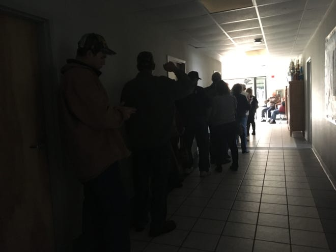 Voters wait in dark hallway at Ridgeview Christian School in Stuarts Draft on Election Day. The polling place lost power but voting didn't stop.