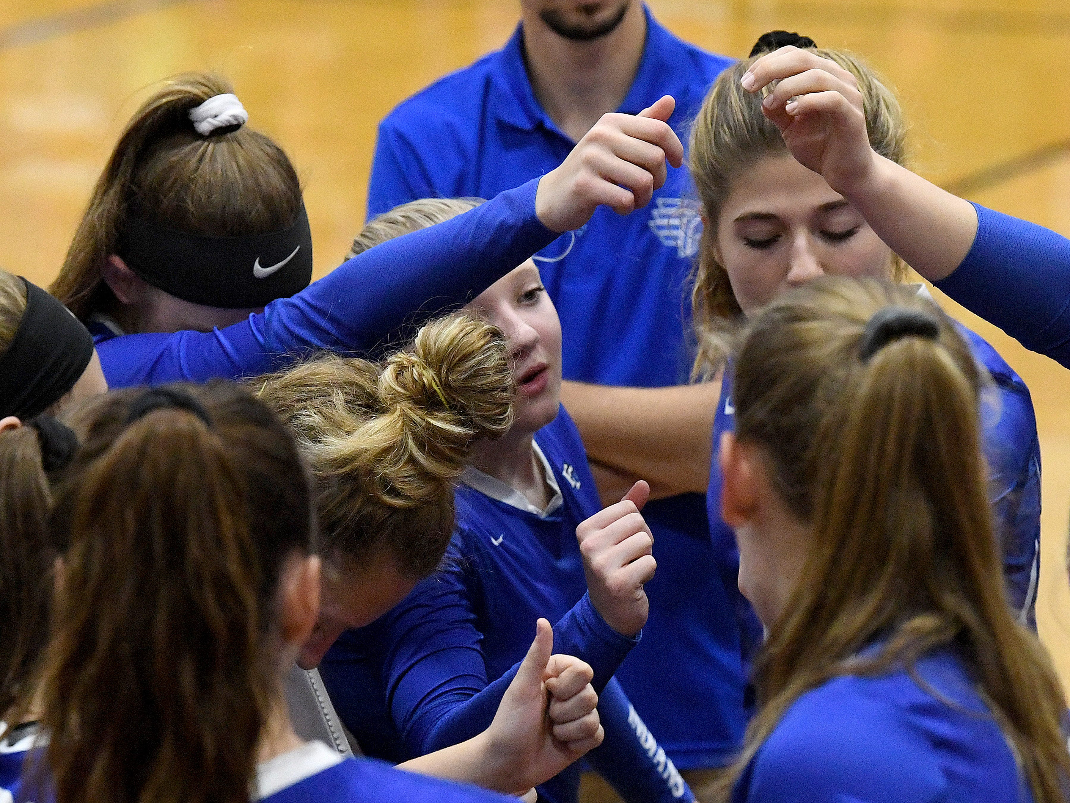 Fort Defiance comes together as a team on the sidelines during a Region 3C semifinal match played in Lexington on Monday, Nov. 5, 2018.