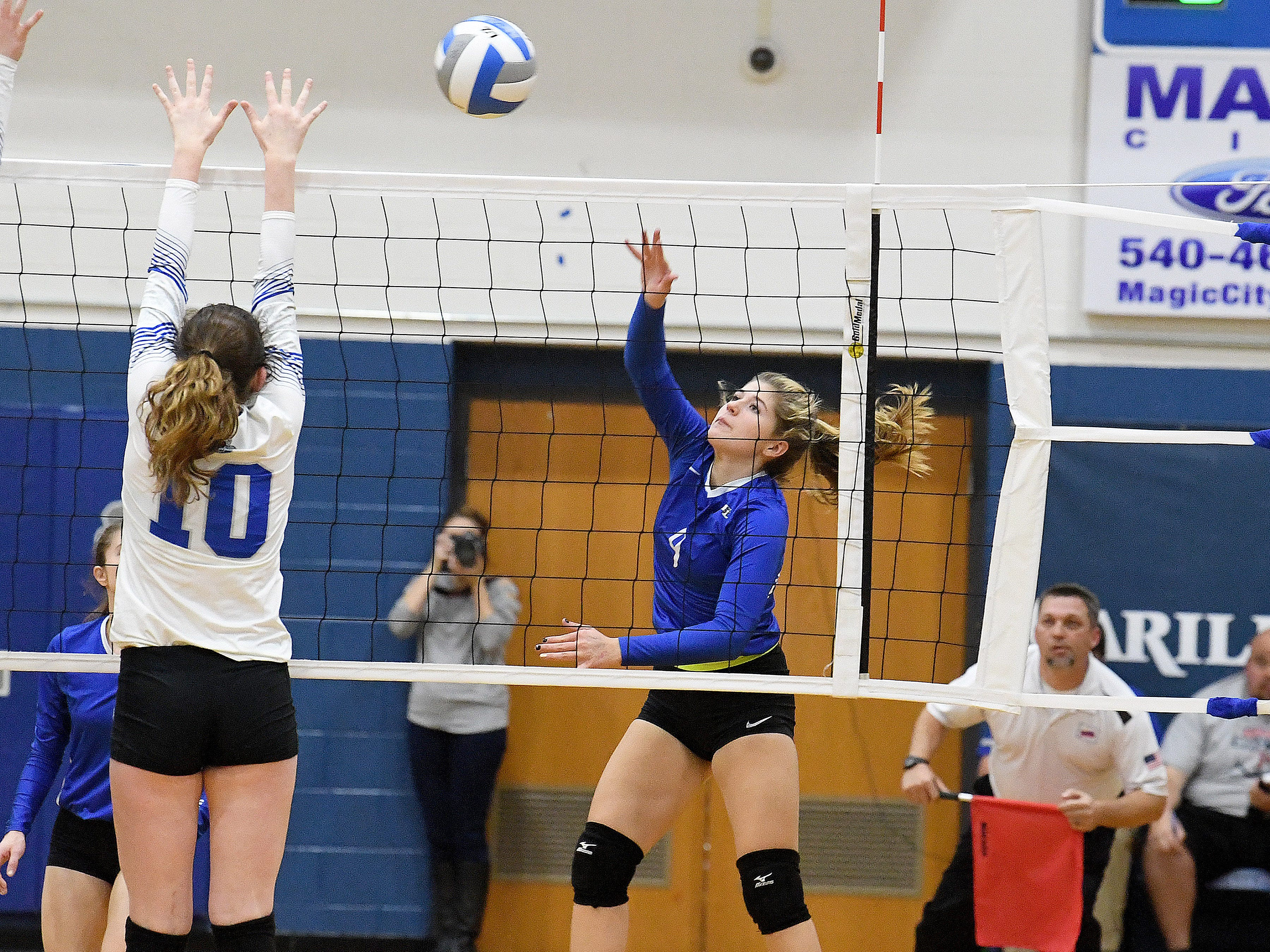 Fort Defiance's Jessi Hull hits the ball back across the net during a Region 3C semifinal match played in Lexington on Monday, Nov. 5, 2018.