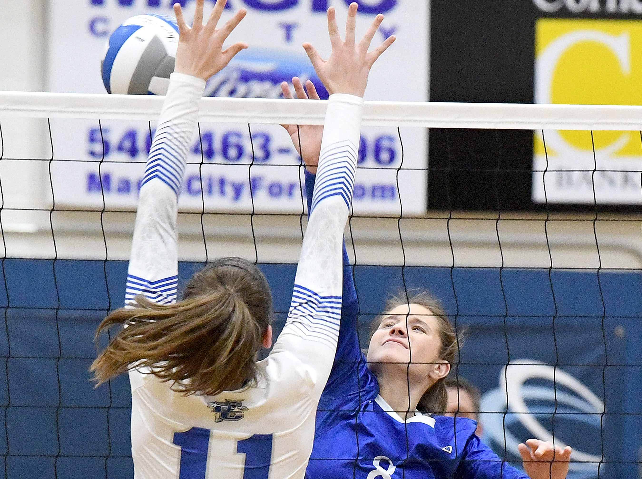 Fort Defiance's Caseuy Mozingo sends the ball back across the net as Rockbridge County's McKenna Mohler tries to block at the net during a Region 3C semifinal match played in Lexington on Monday, Nov. 5, 2018.