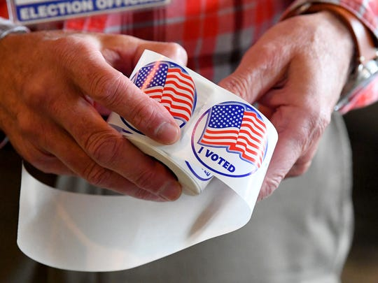 """""""I Voted"""" stickers ready to be handed out at the Jolivue Precinct at the Victory Worship Center on Election Day, Tuesday, Nov. 6, 2018."""