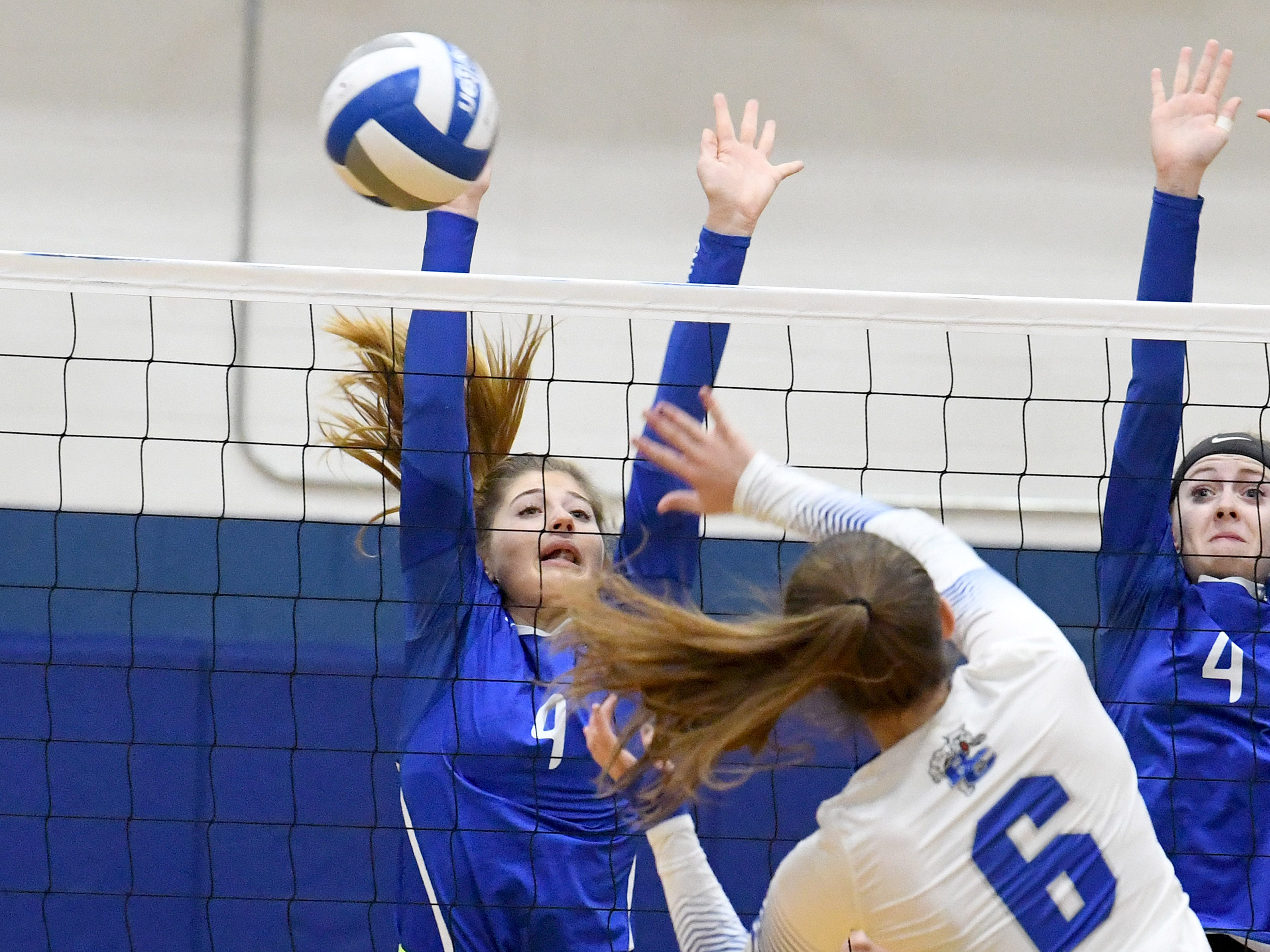 Fort Defiance's Leilani Goggin tries to block a spike by Rockbridge County's Jaydyn Clemmer during a Region 3C semifinal match played in Lexington on Monday, Nov. 5, 2018.